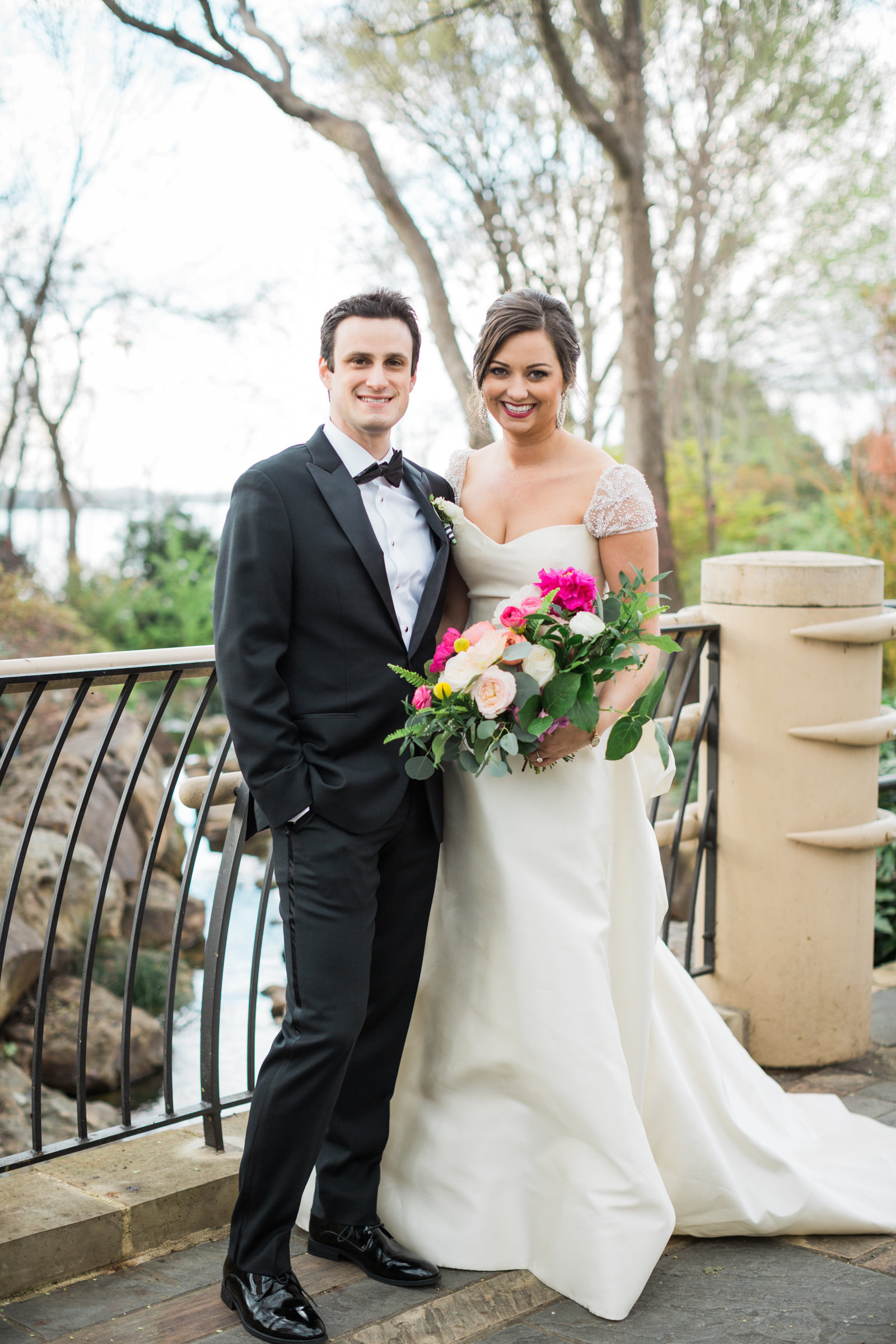 the bride and groom at the dallas arboretum and botanical garden