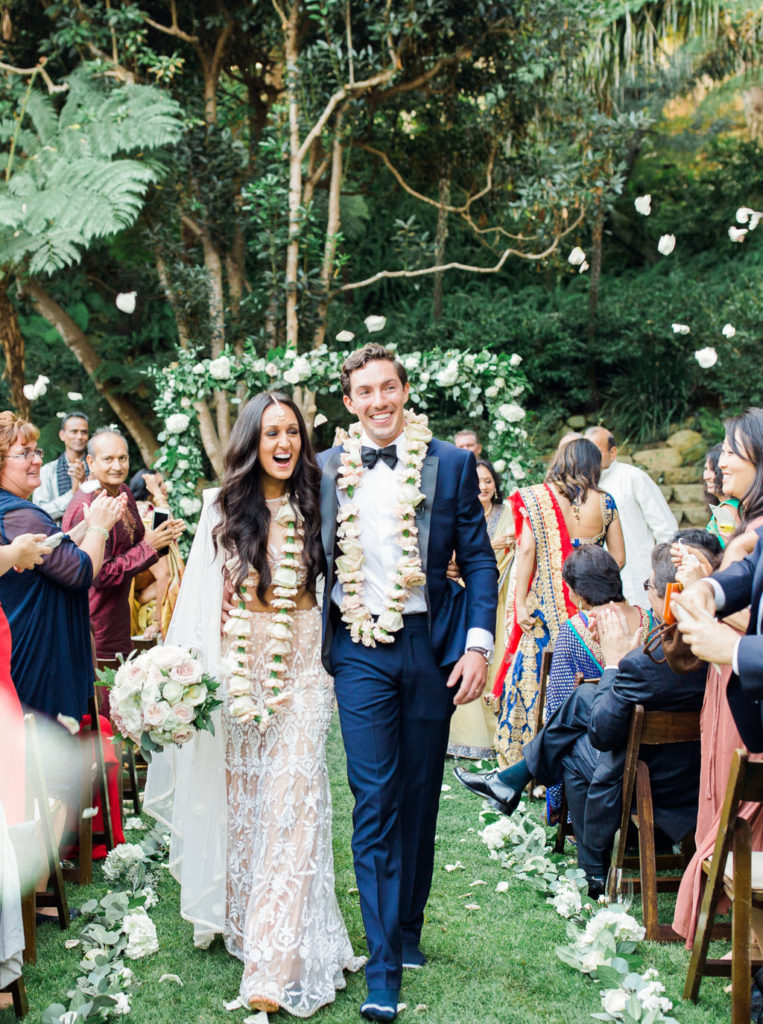 Bride and groom walk down aisle after blended Indian and Christian wedding ceremony at Butterfly Lane Estate in Montecito