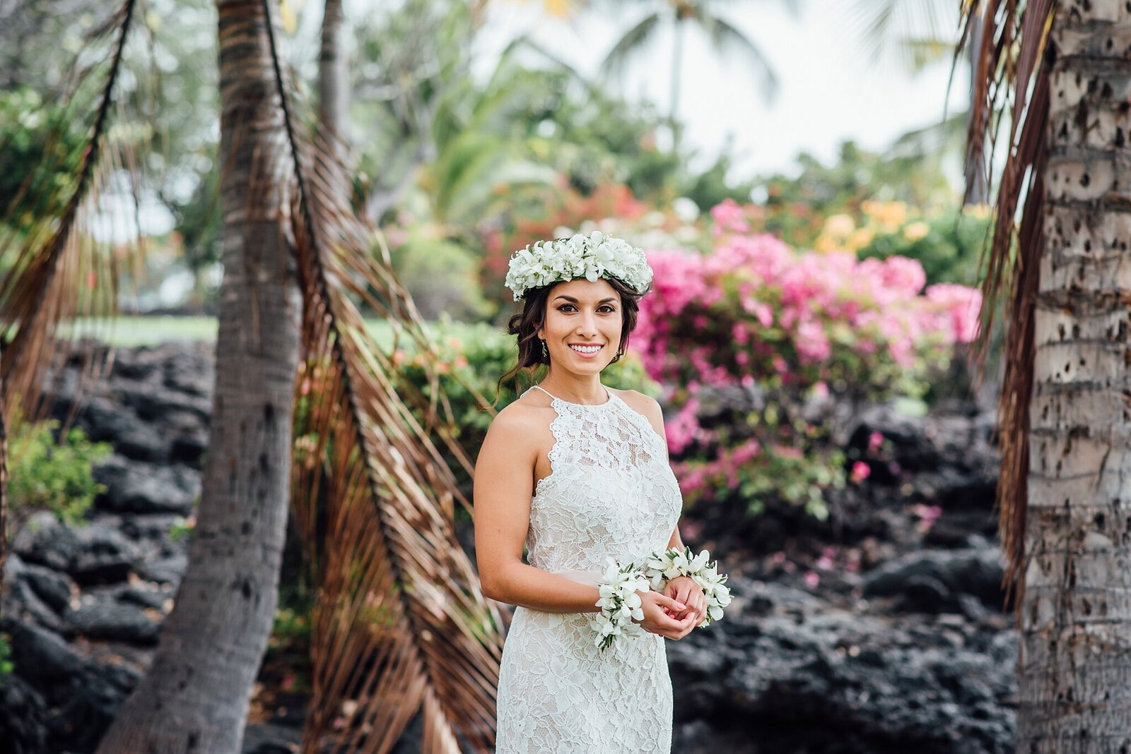 bride with beautiful head haku lei