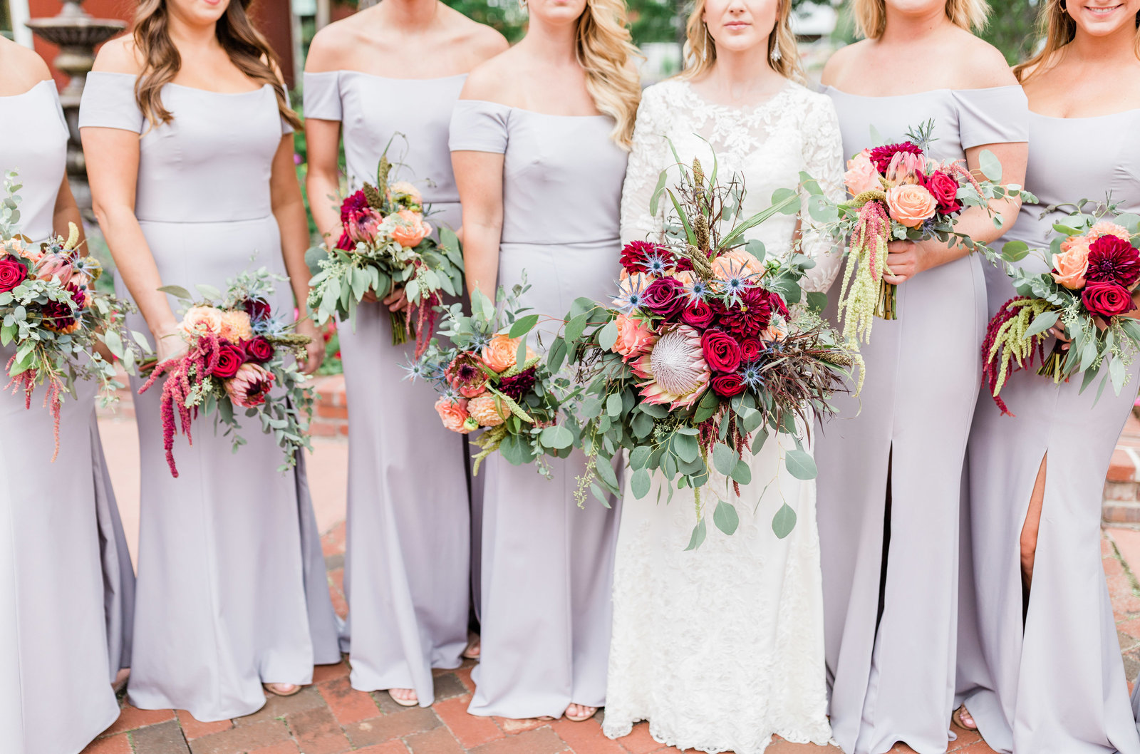 bridesmaid's holding bouquets