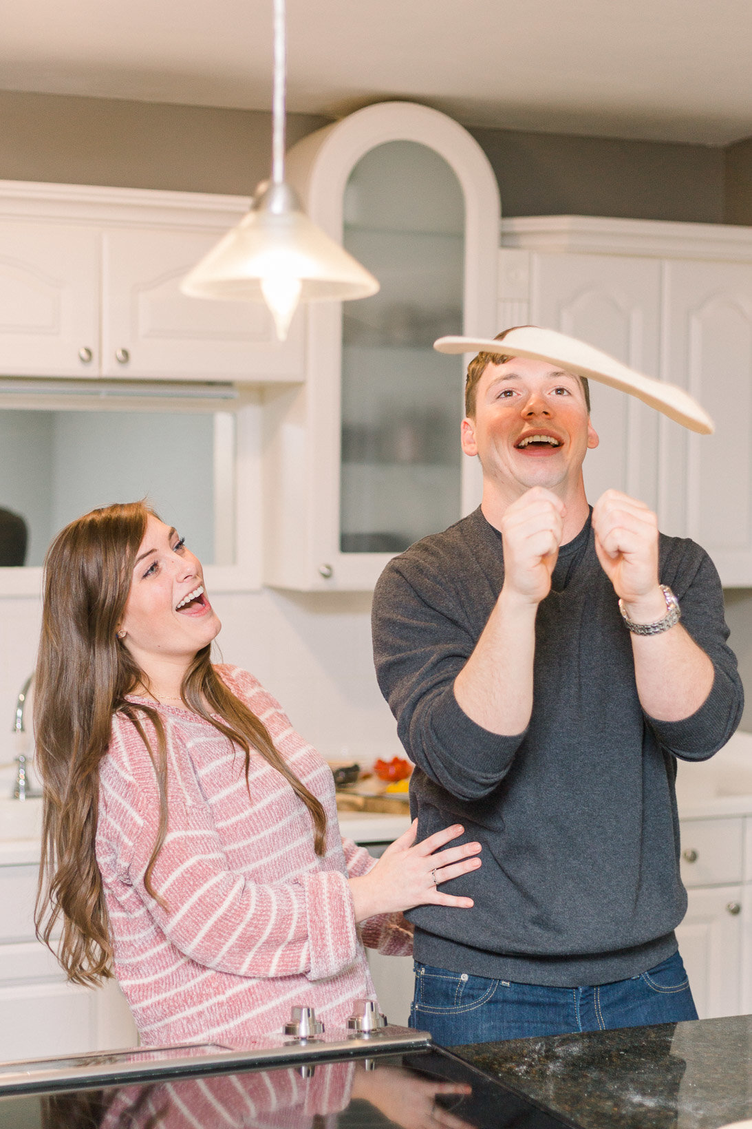 Tossing pizza dough captured by Staci Addison Photography