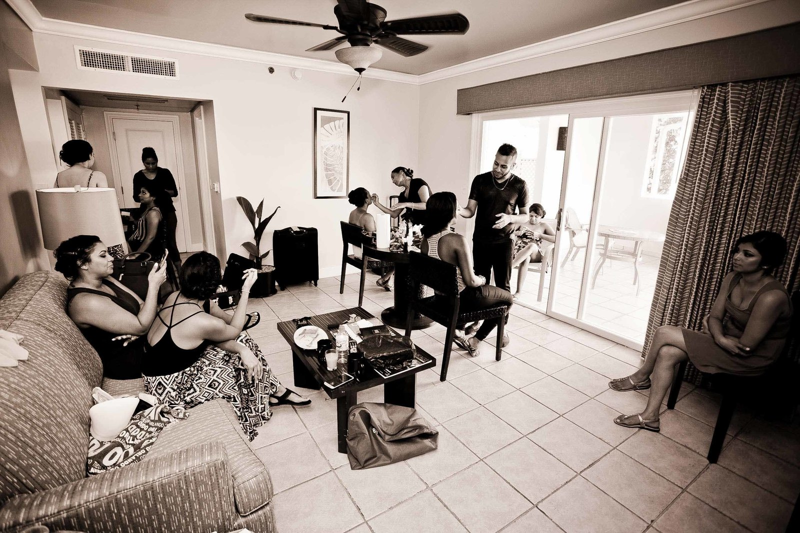 Family getting ready for the wedding  in B+W. Photo by Ross Photography, Trinidad, W.I..