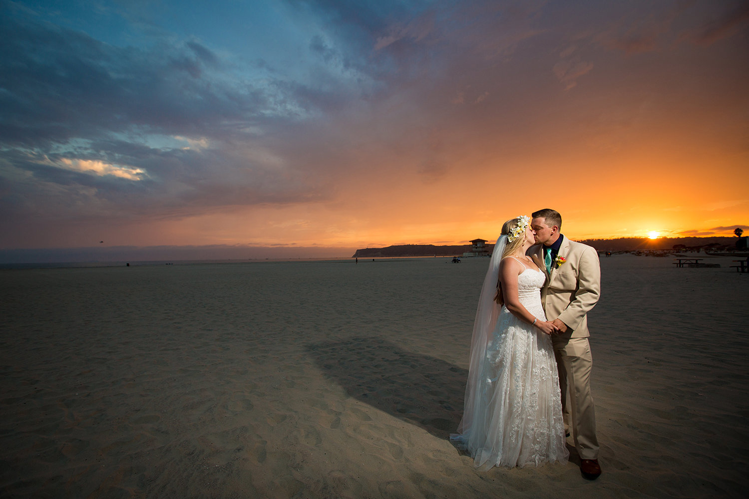 bride and groom at sunset on beach breakers beach