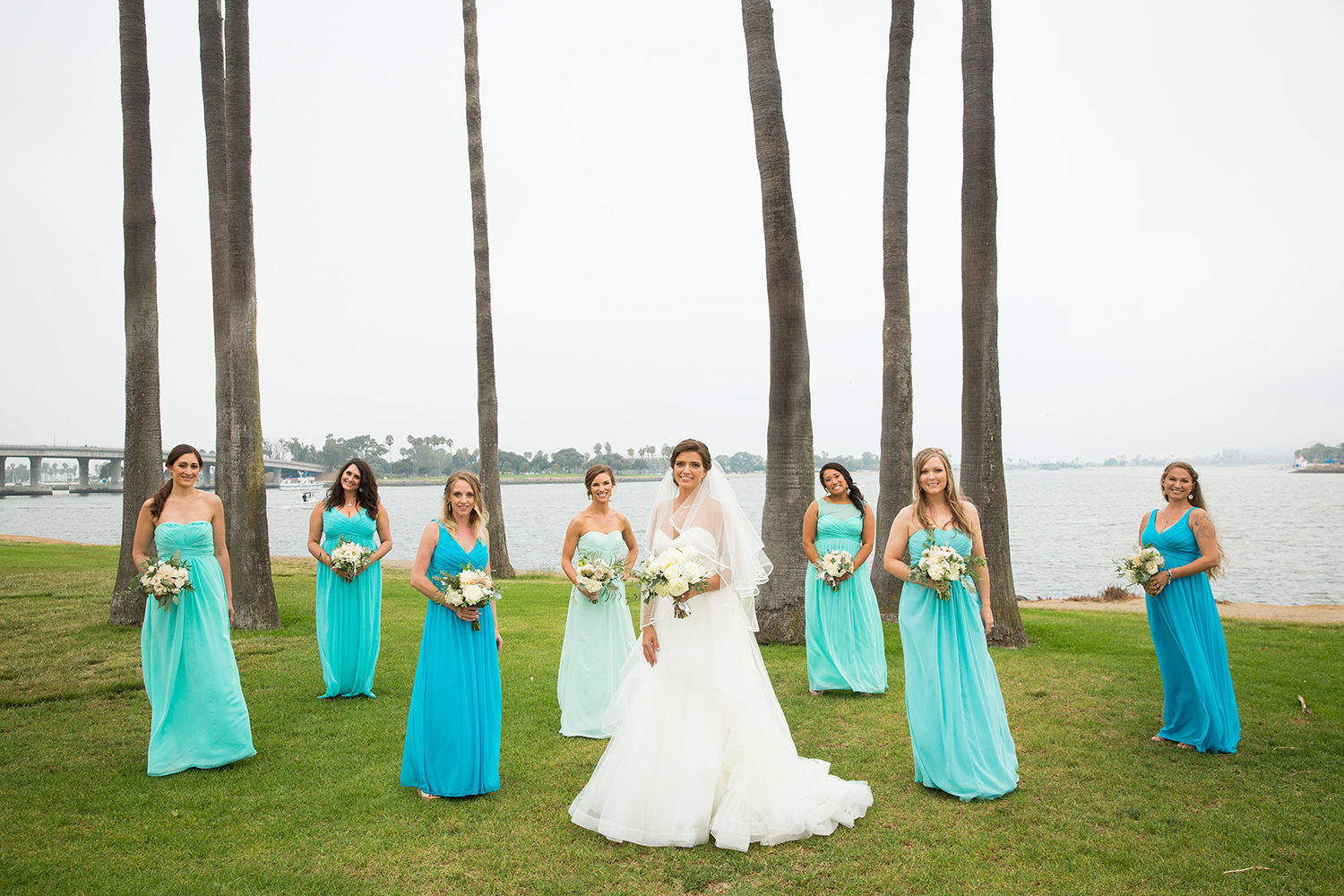 bridesmaids in teal and coral dresses