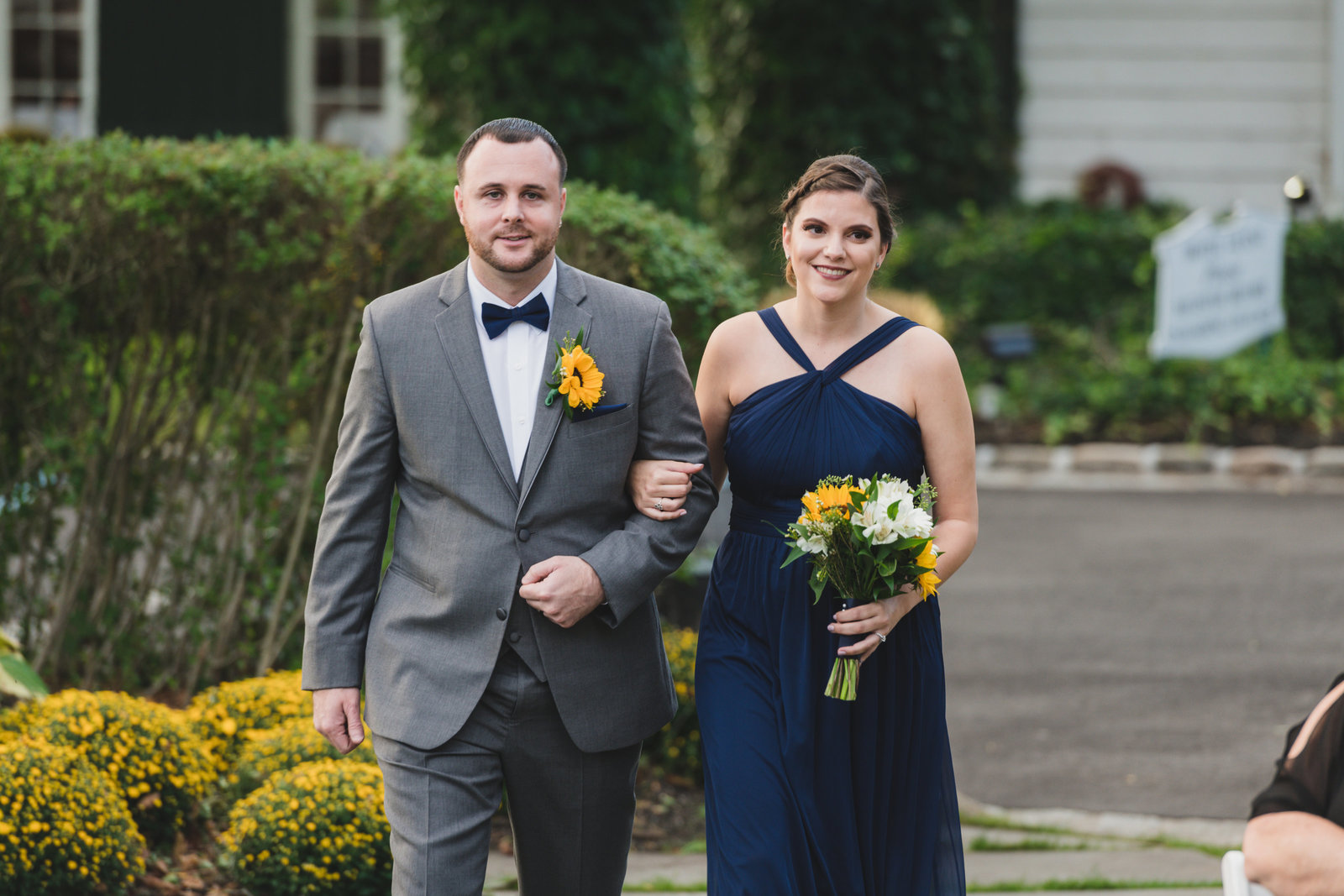 photo of bridesmaid and groomsmen walking down the aisle from wedding at Three Village Inn