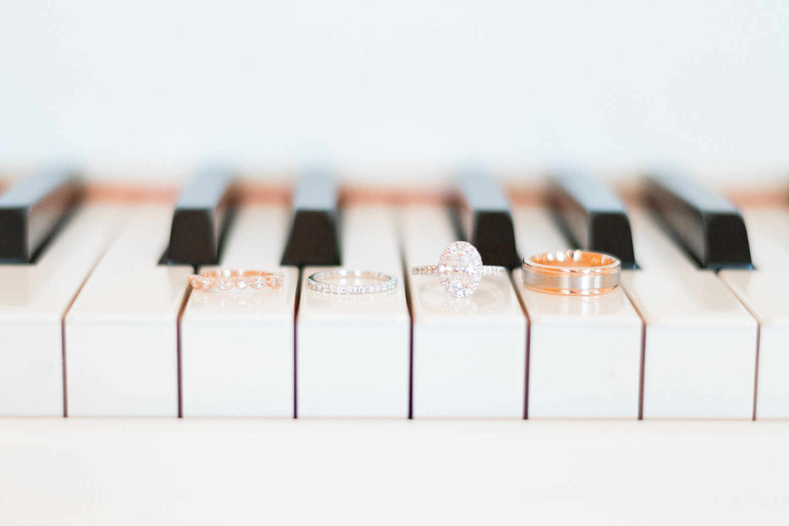 charlotte wedding photographer shot of Detail shot of rings on grand piano