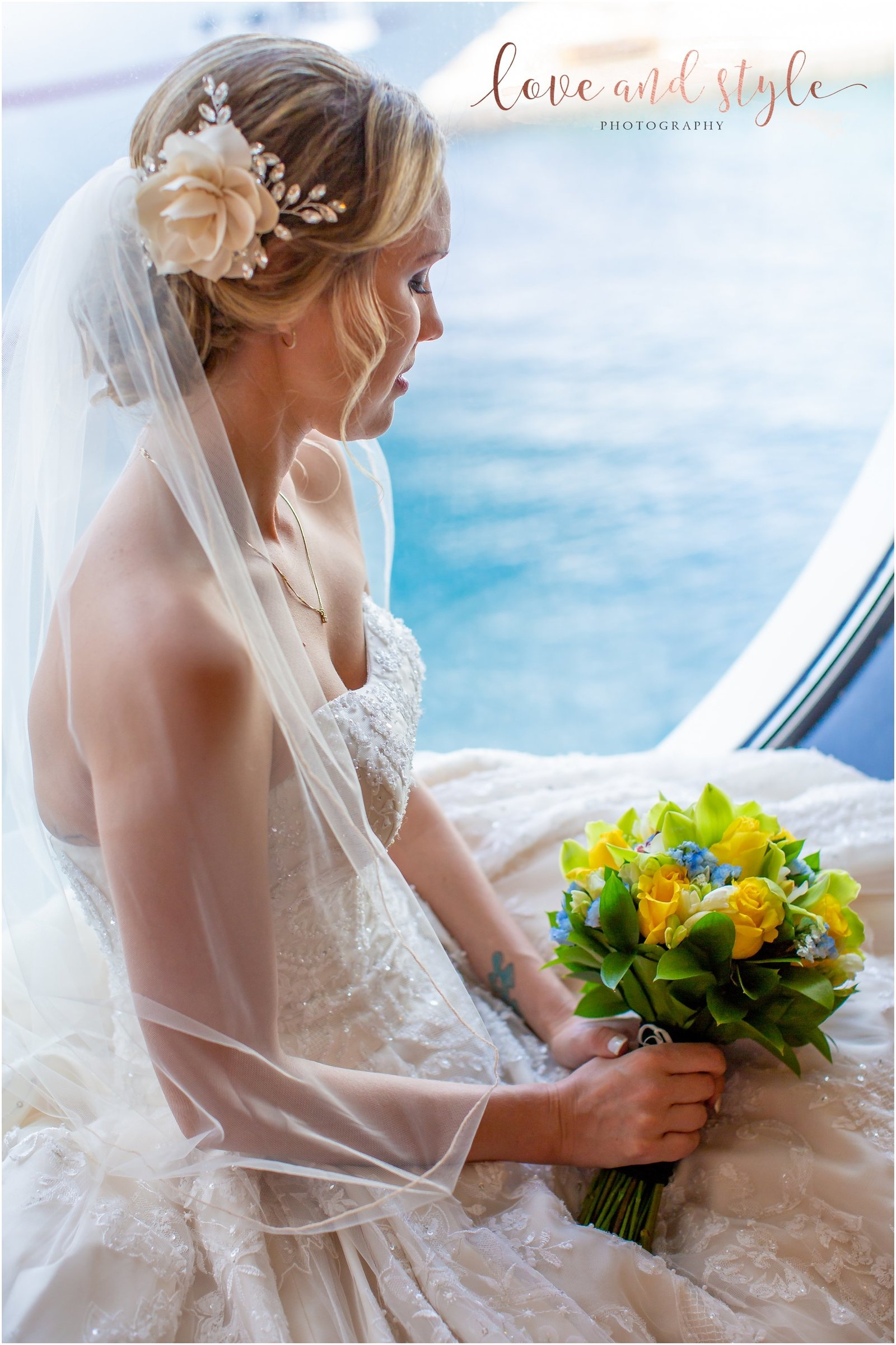 Disney Dream Cruise Wedding Photography bridal portrait with bride sitting in the porthole holding her flowers