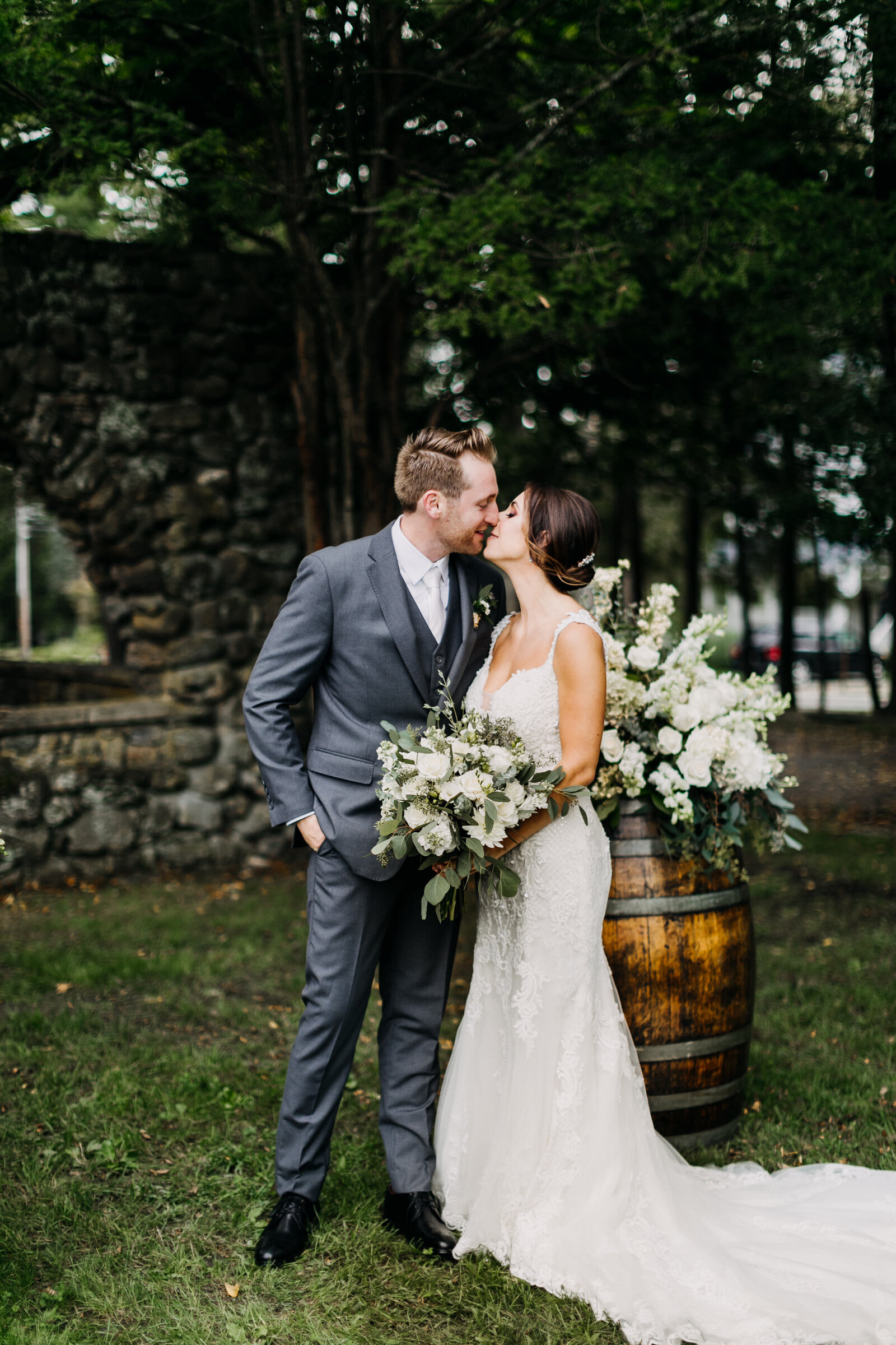 bride and groom kissing at winery