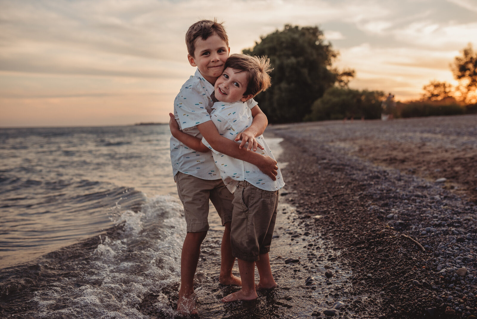 Two young boys hugging at Courtice Beach
