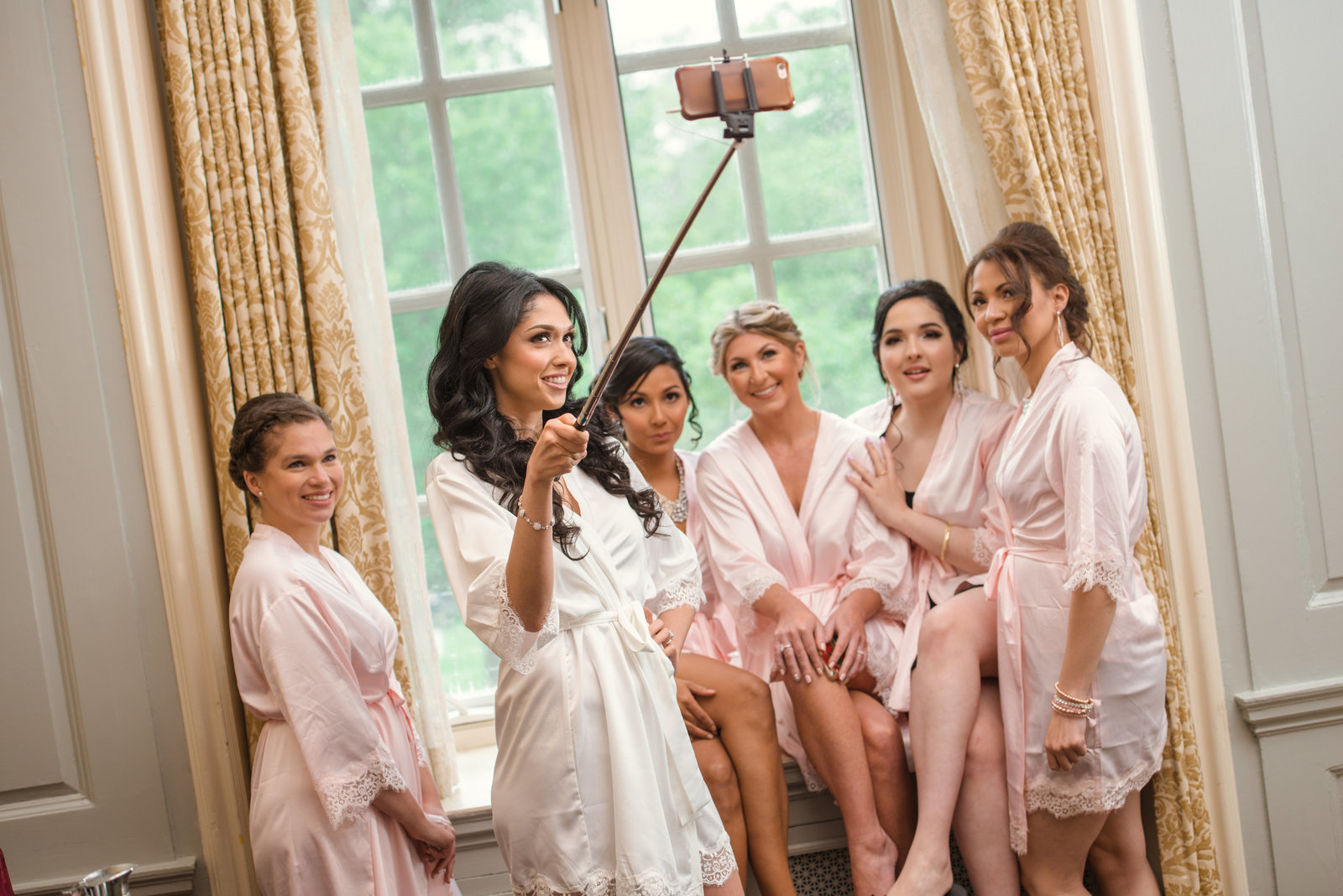 Bridesmaids selfie with the bride at Glen Cove Mansion
