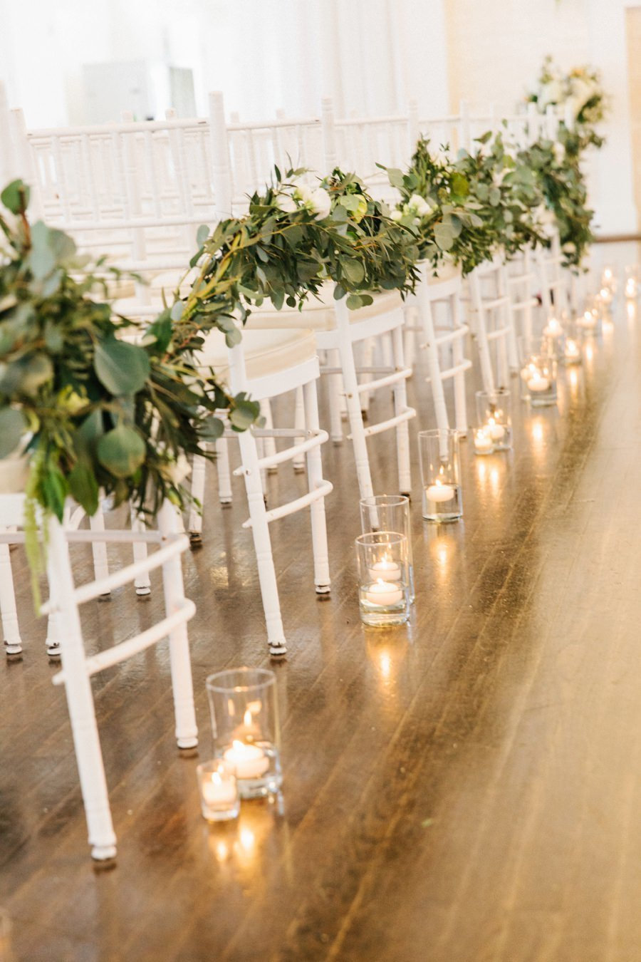 Modern & clean indoor wedding ceremony aisle decor at Belle Mer in Newport, RI