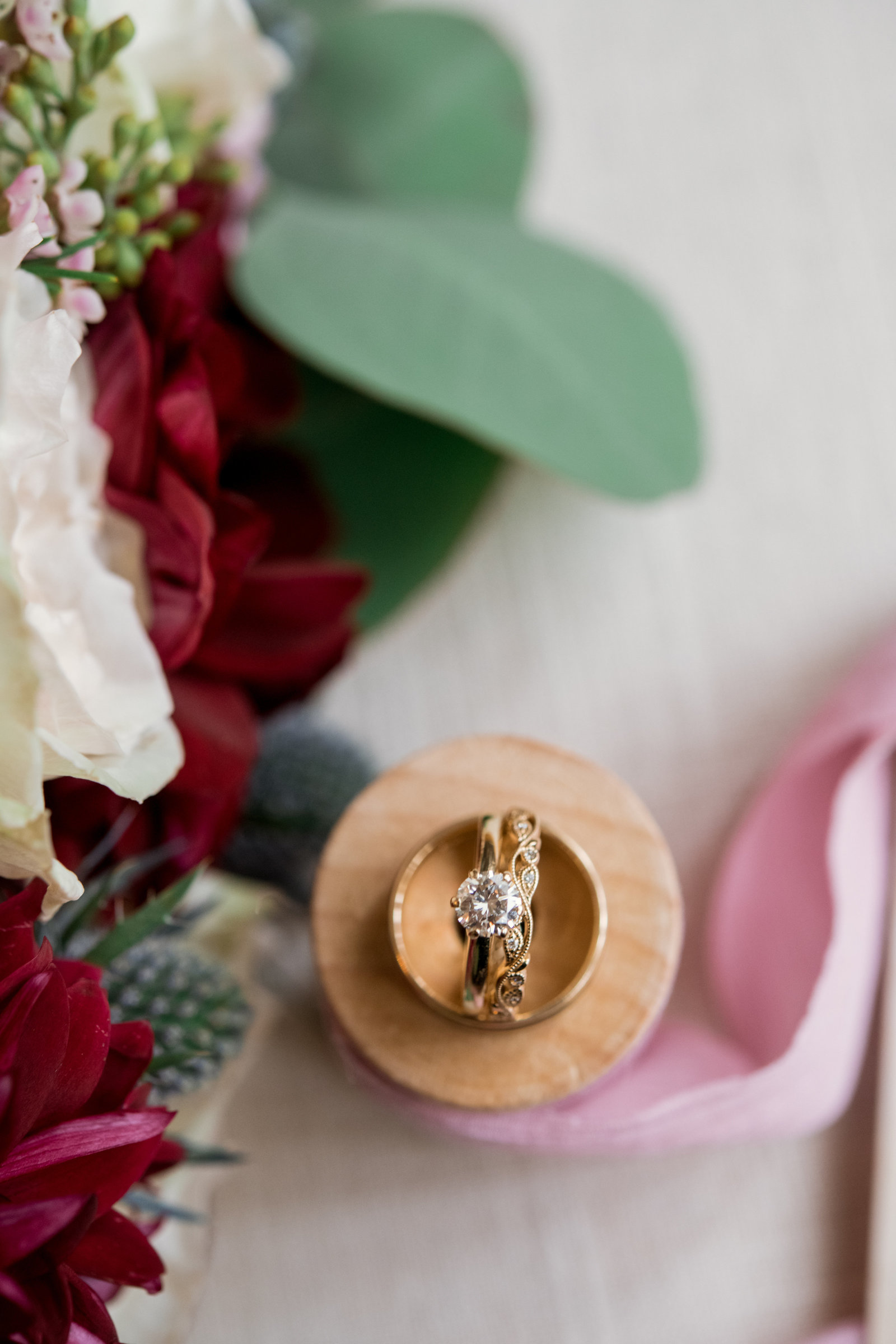 creative photos of wedding rings at Coindre Hall