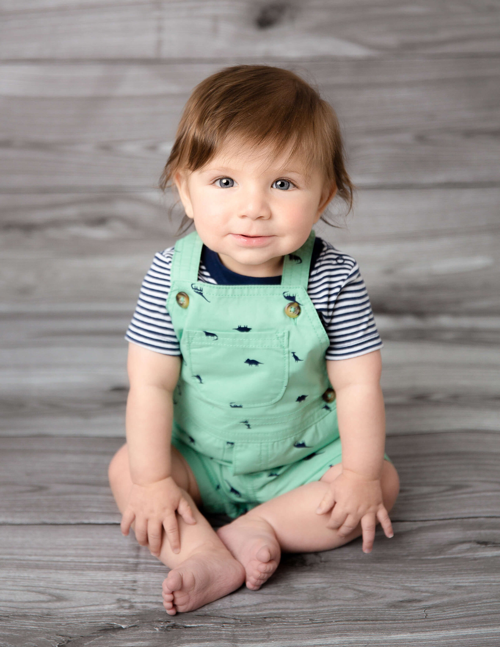 Cute boy posed at our in-home studio in Rochester, Ny.