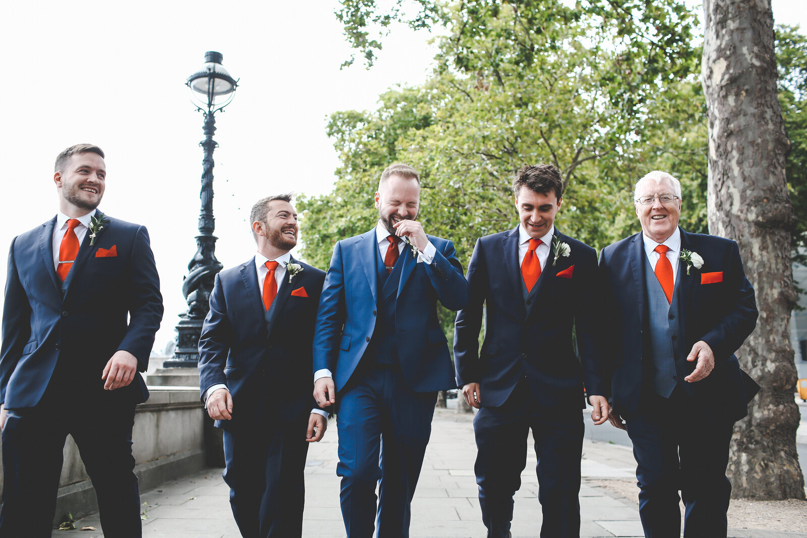 WP-LONDON-WEDDING-GROOMSMEN-WALK-THAMES-LAUGHING_0005