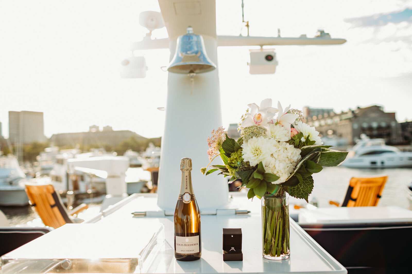 champagne and a ring on board a yacht in boston