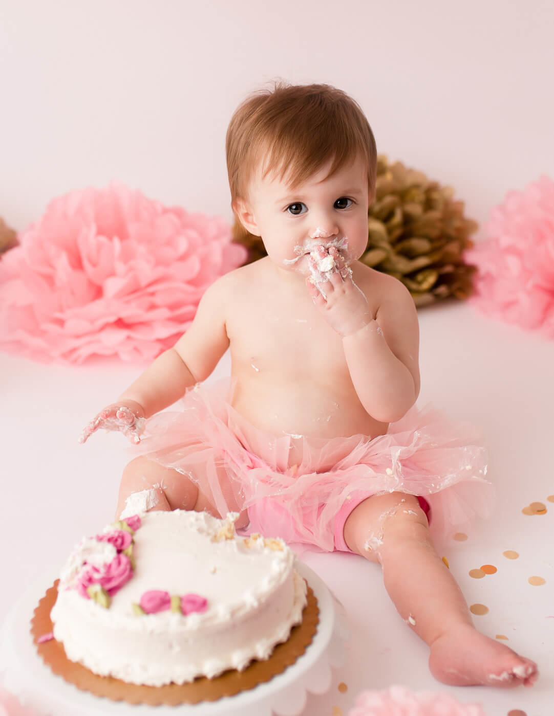 One year old cake smash in Rochester, NY.