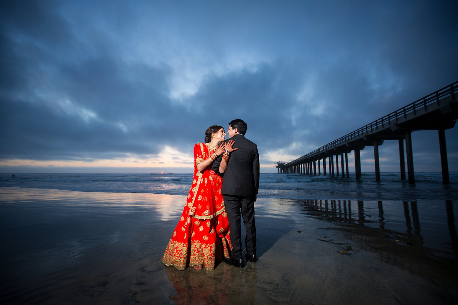 Sunset Wedding Portrait at Scripps Pier of Bright Hindu Couple