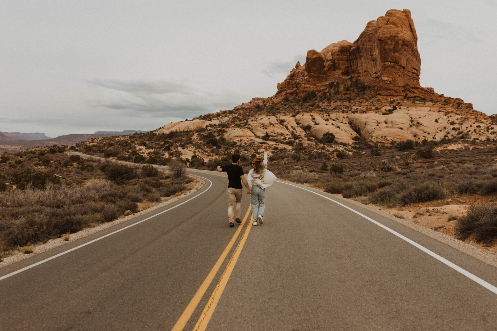 Couple running through the street in a National Park