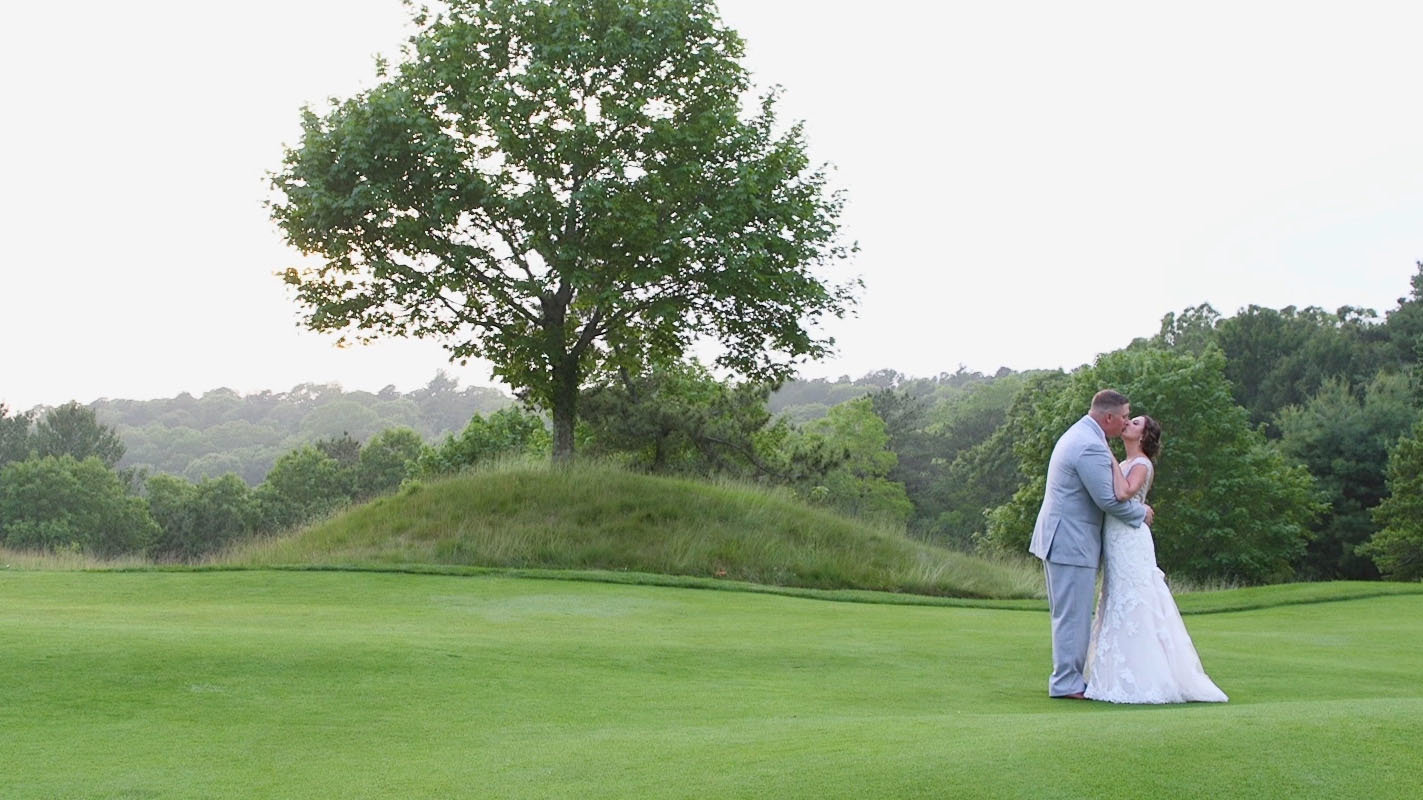 Cape Cod Wedding kissing on golf course
