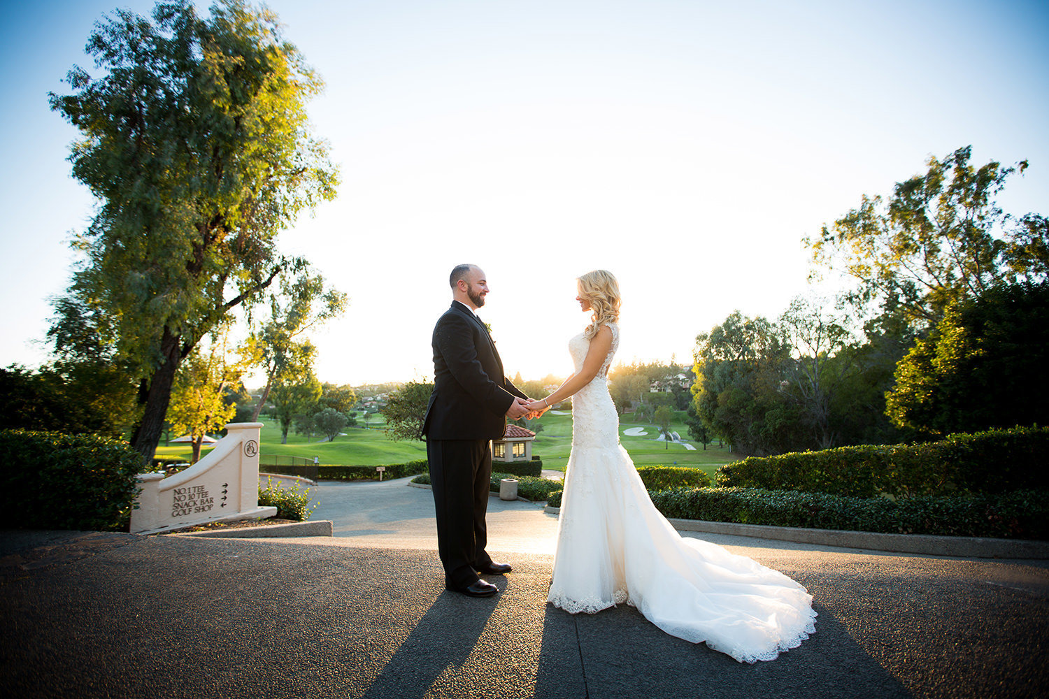 Bride and groom hold hands with stunning view at Rancho Bernardo Inn