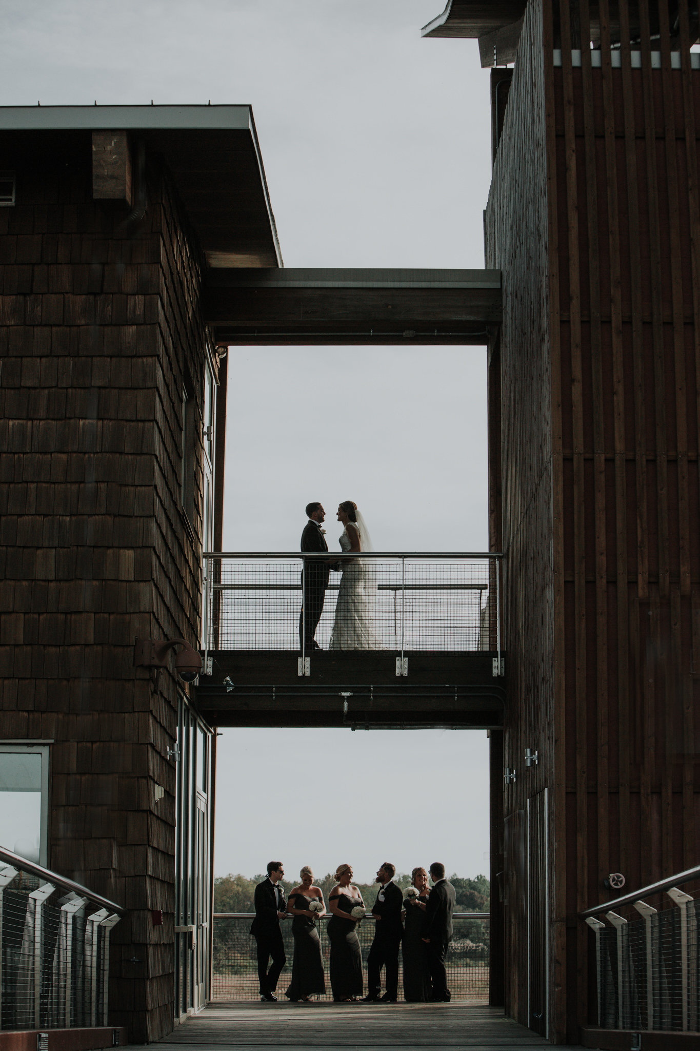bridal party at the dupont environmental education center on the riverfront in wilmngton delaware