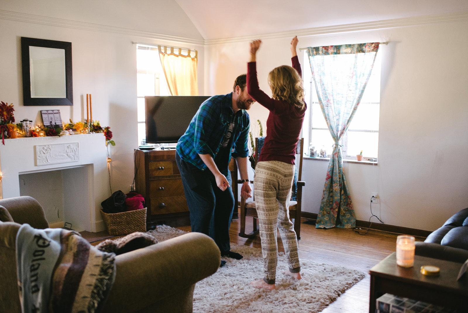 Columbus OH couple dancing in living room in pajamas