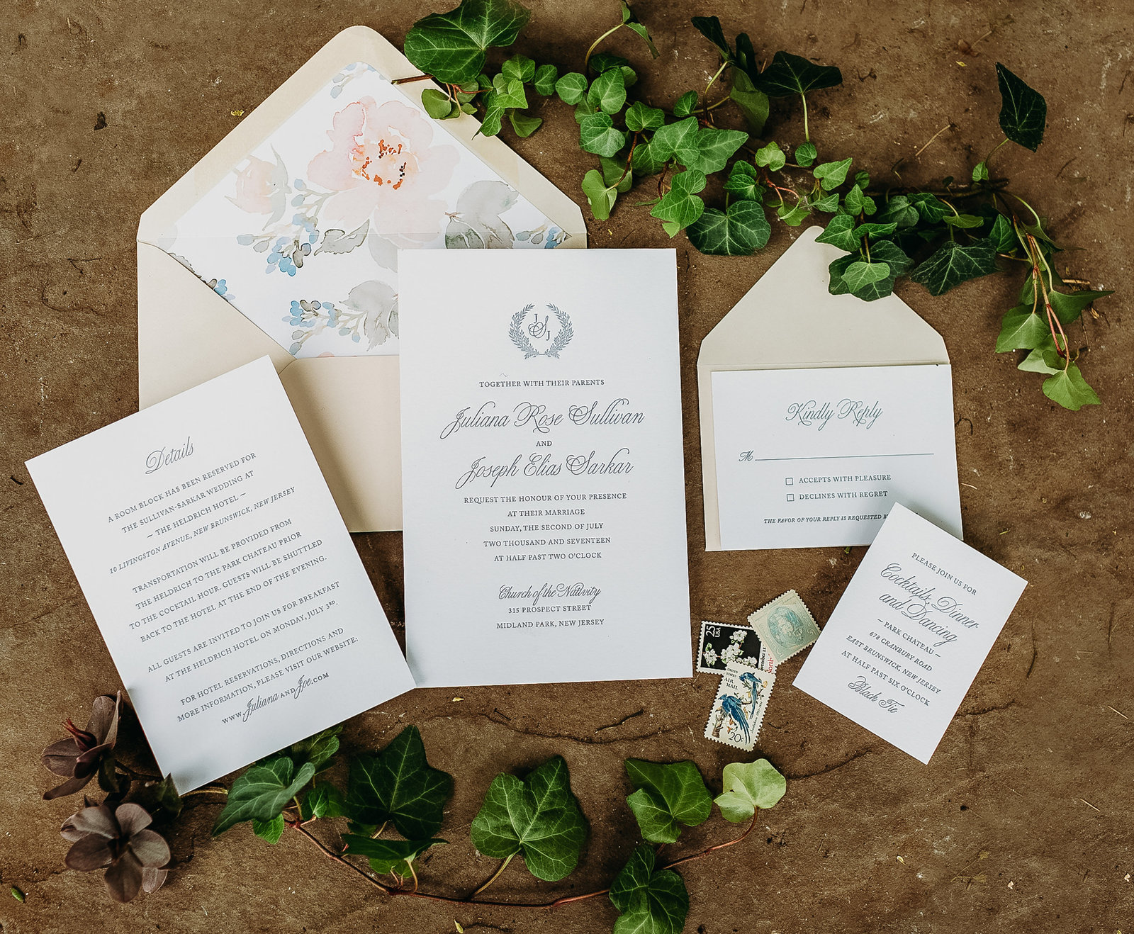 wedding invitation suite laid out with greenery