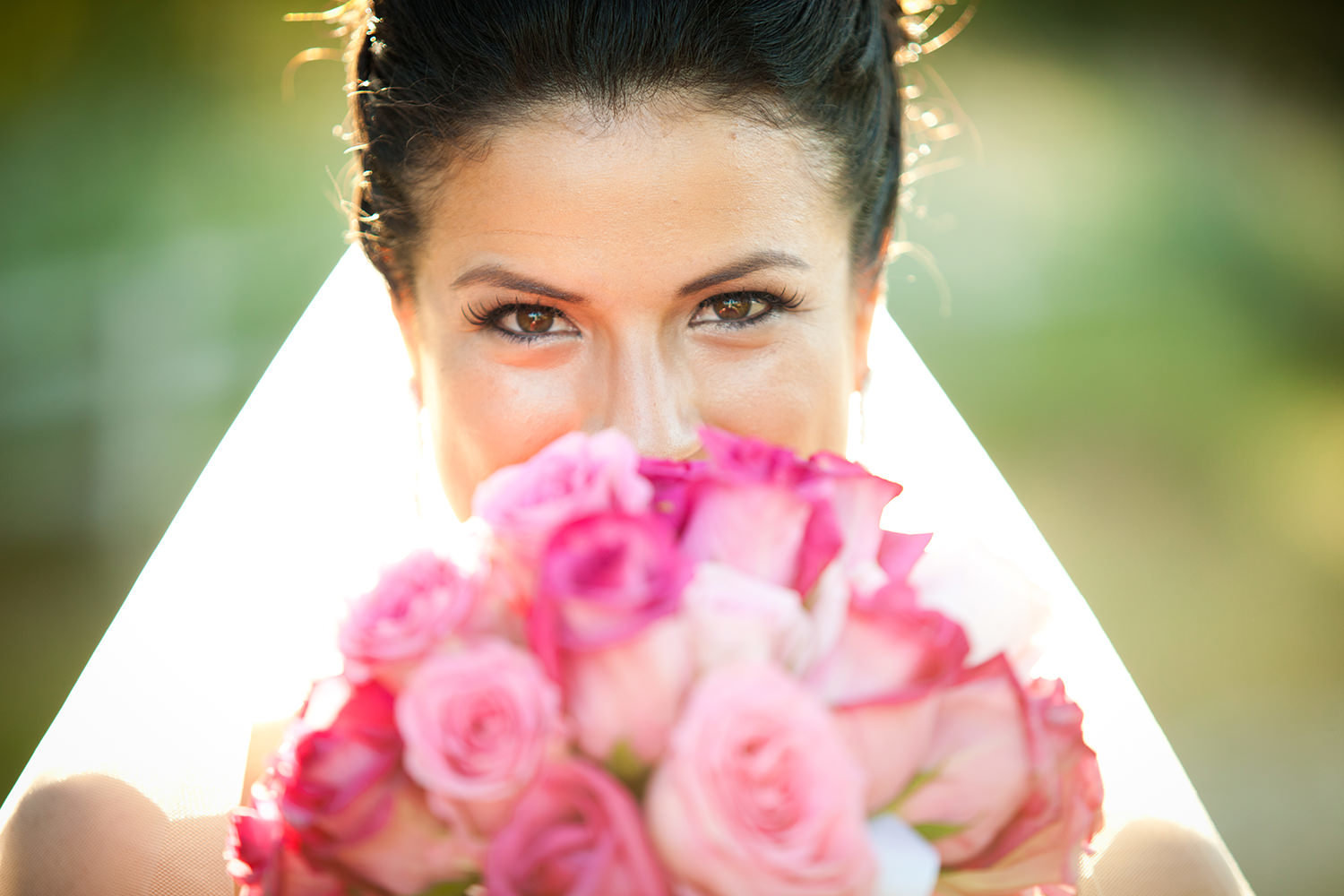 bride at the stunning wedgewood pink flowers