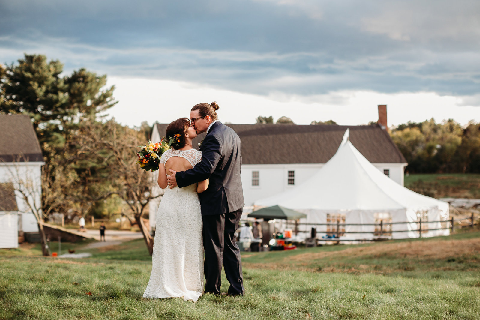 bride and groom share kiss on a farm wedding in massachusetts