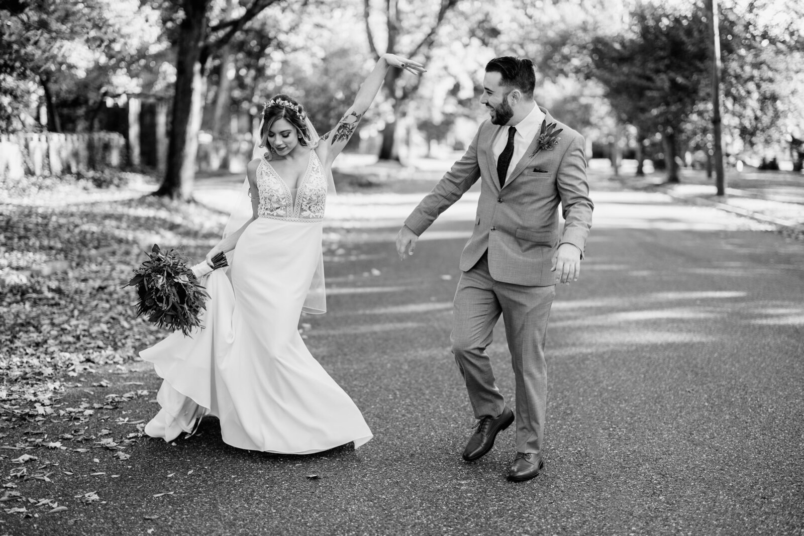 bride and groom dancing in the street
