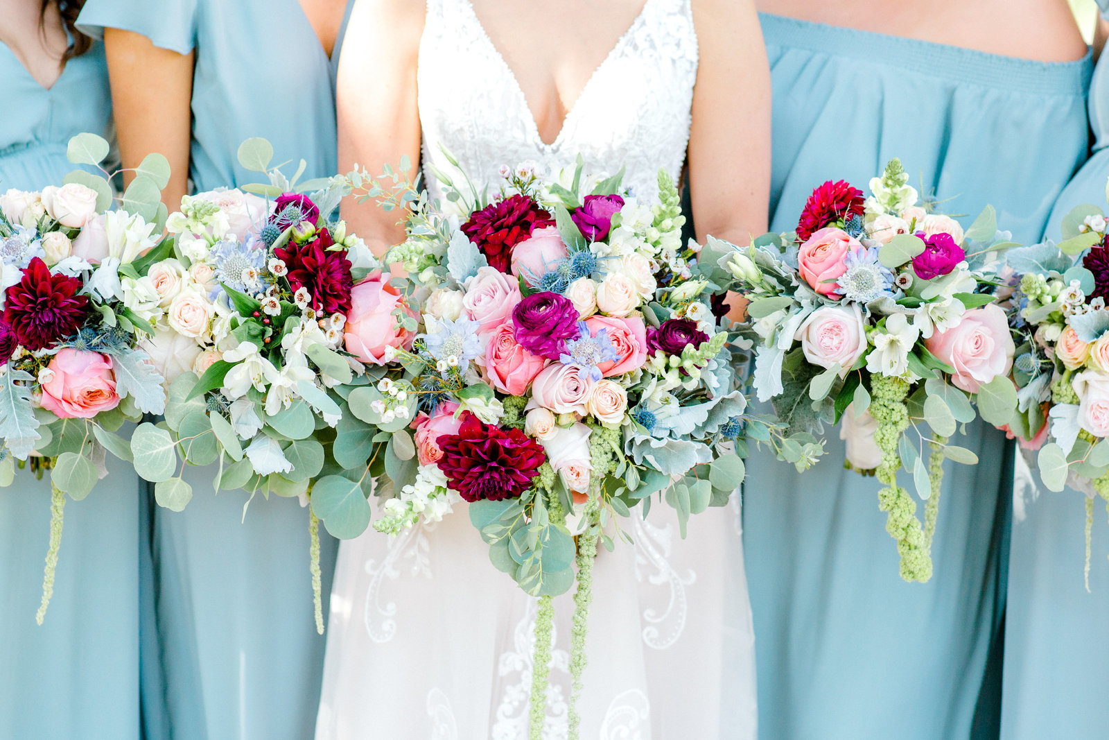 Bouquets with pastel colors and a pop of burgundy
