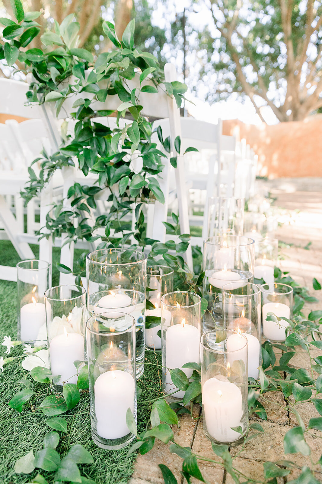 weddings-phoenix-wedding-ceremony-pillar-candles-greenery