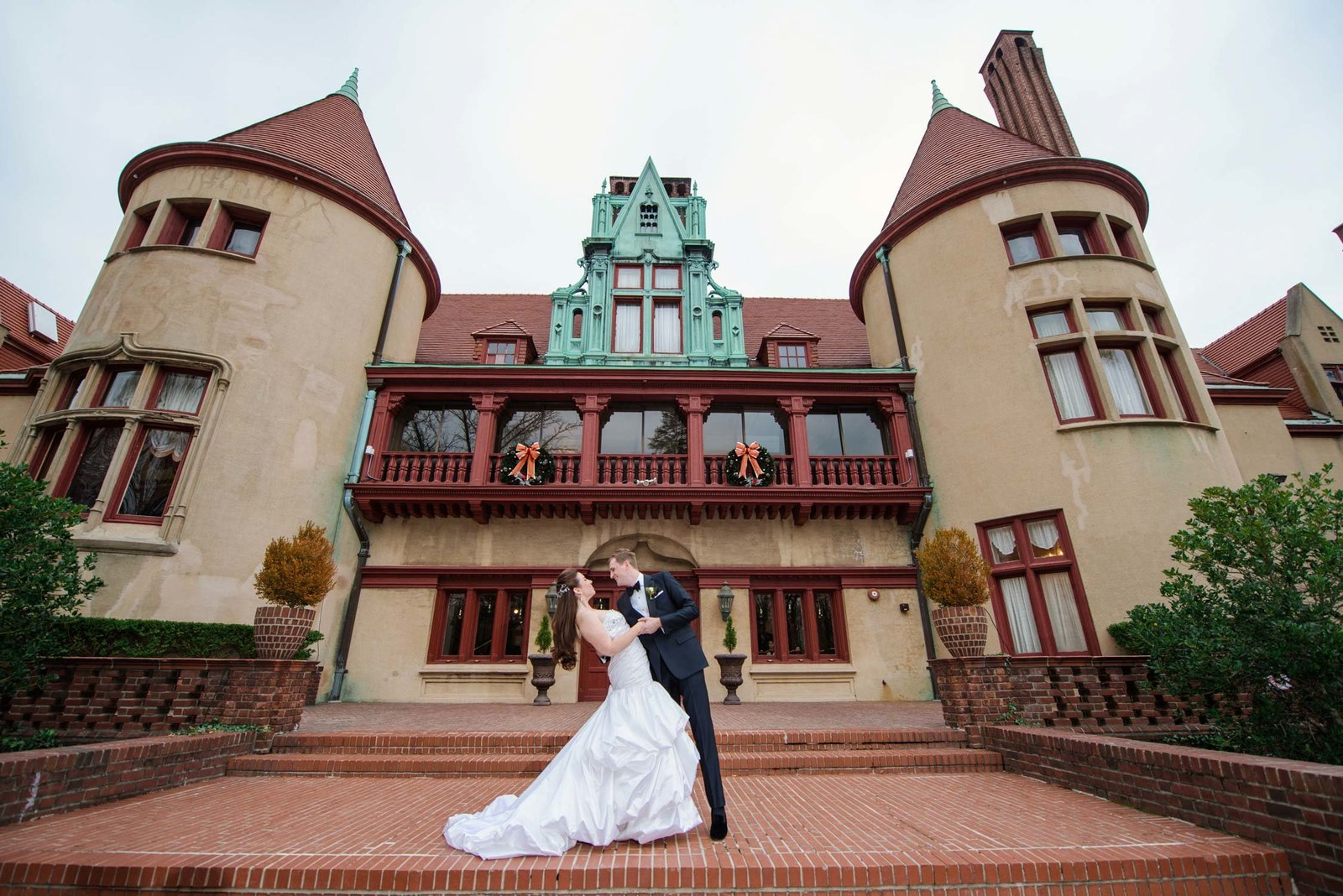 Bride and groom in front of Coindre Hall