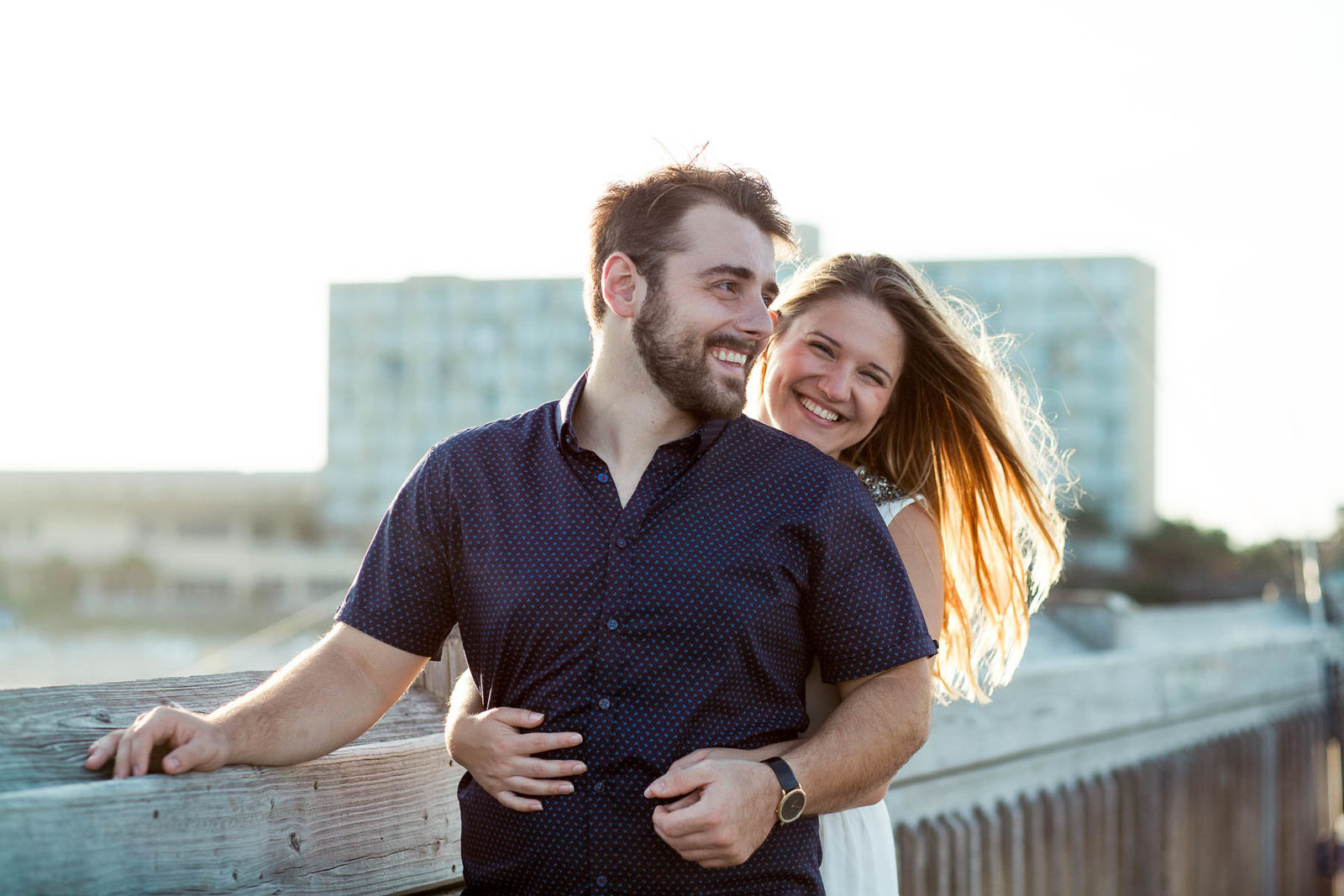 Engaged Couple on fishing pier, Folly beach, Charleston Engagement Photographer.