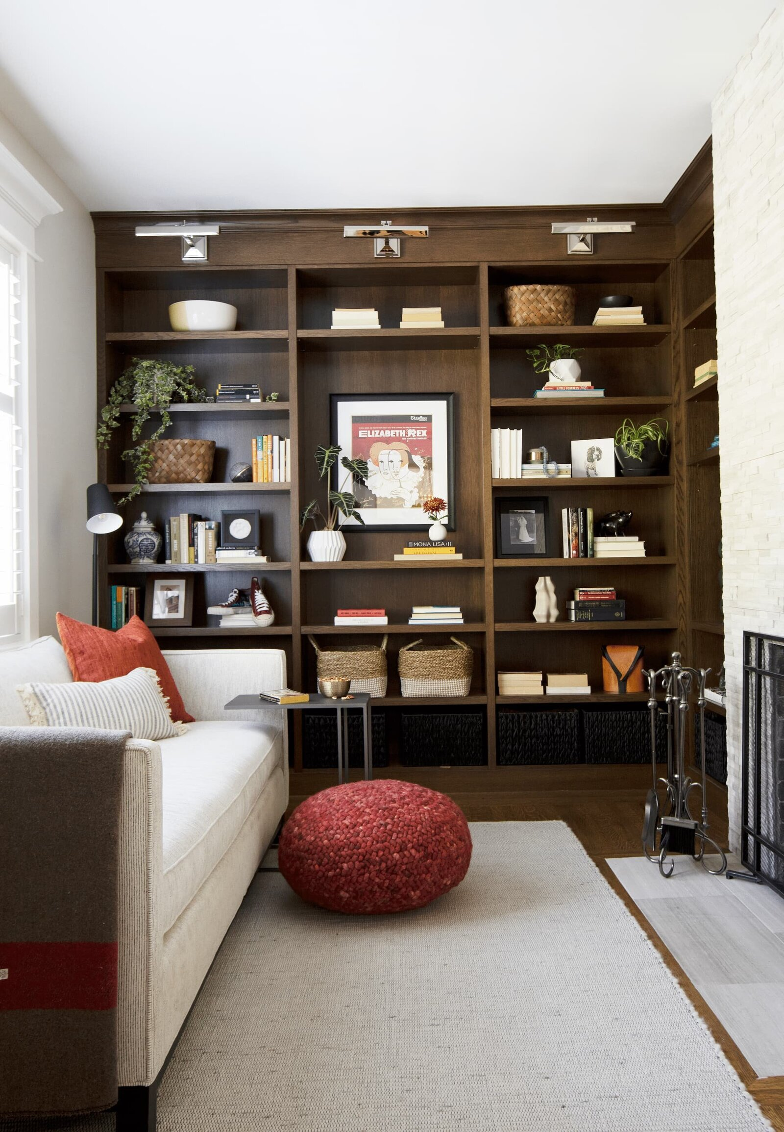 Granville Street l Den-Reading Room l Neutral Sofa, Fireplace, Dark Built-in with Accessories on Shelves
