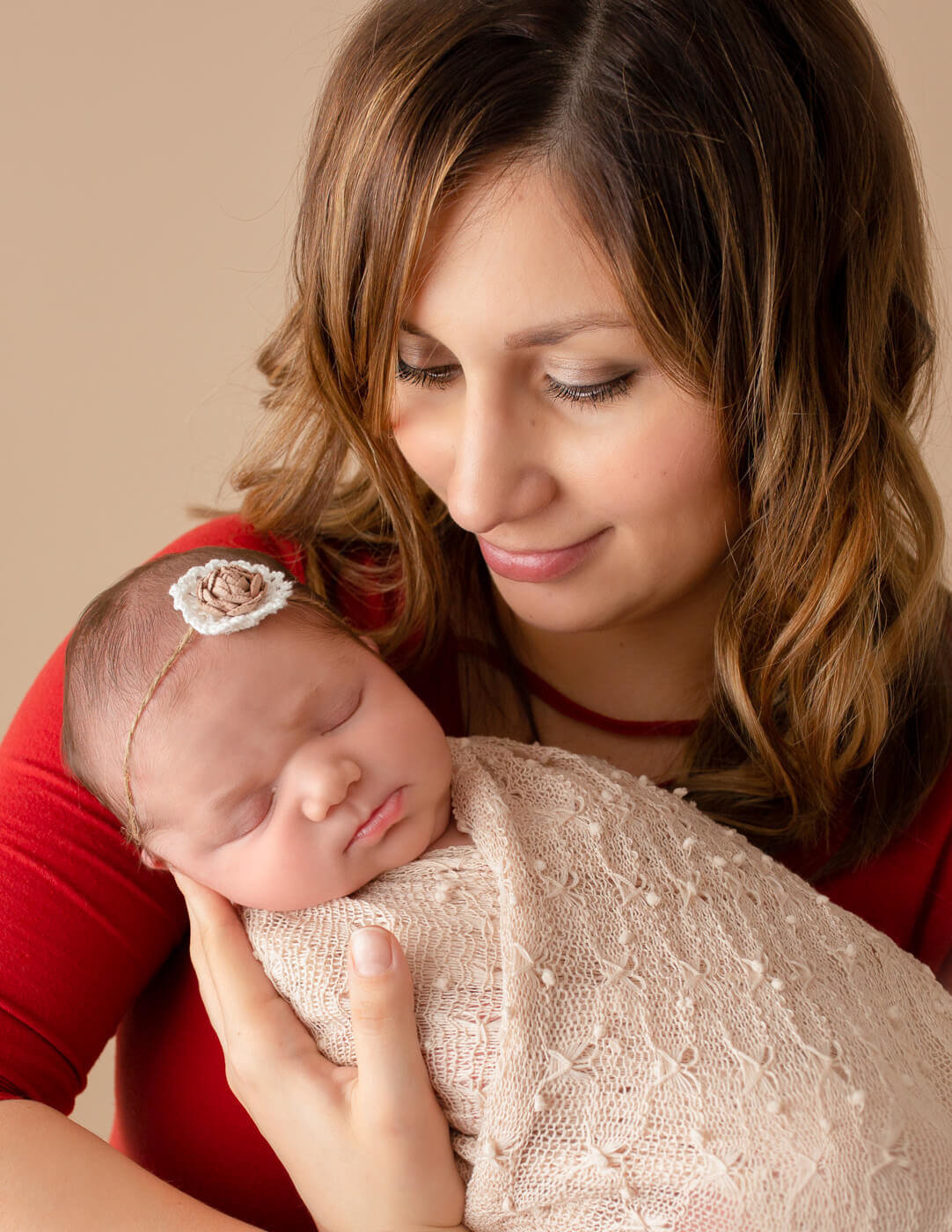 Newborn girl and her mom posed in Rochester, NY.