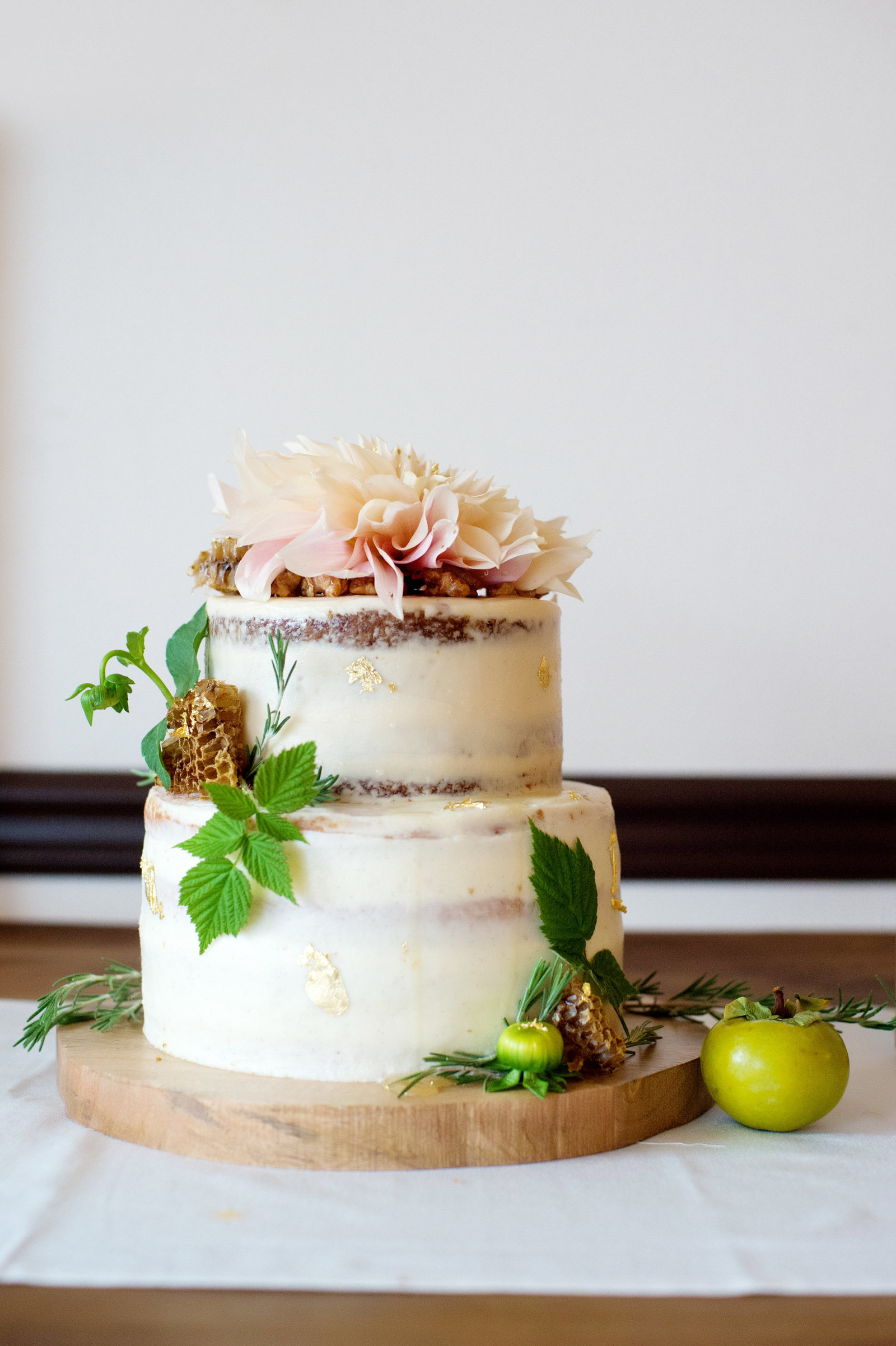 a pretty wedding cake with persimmons