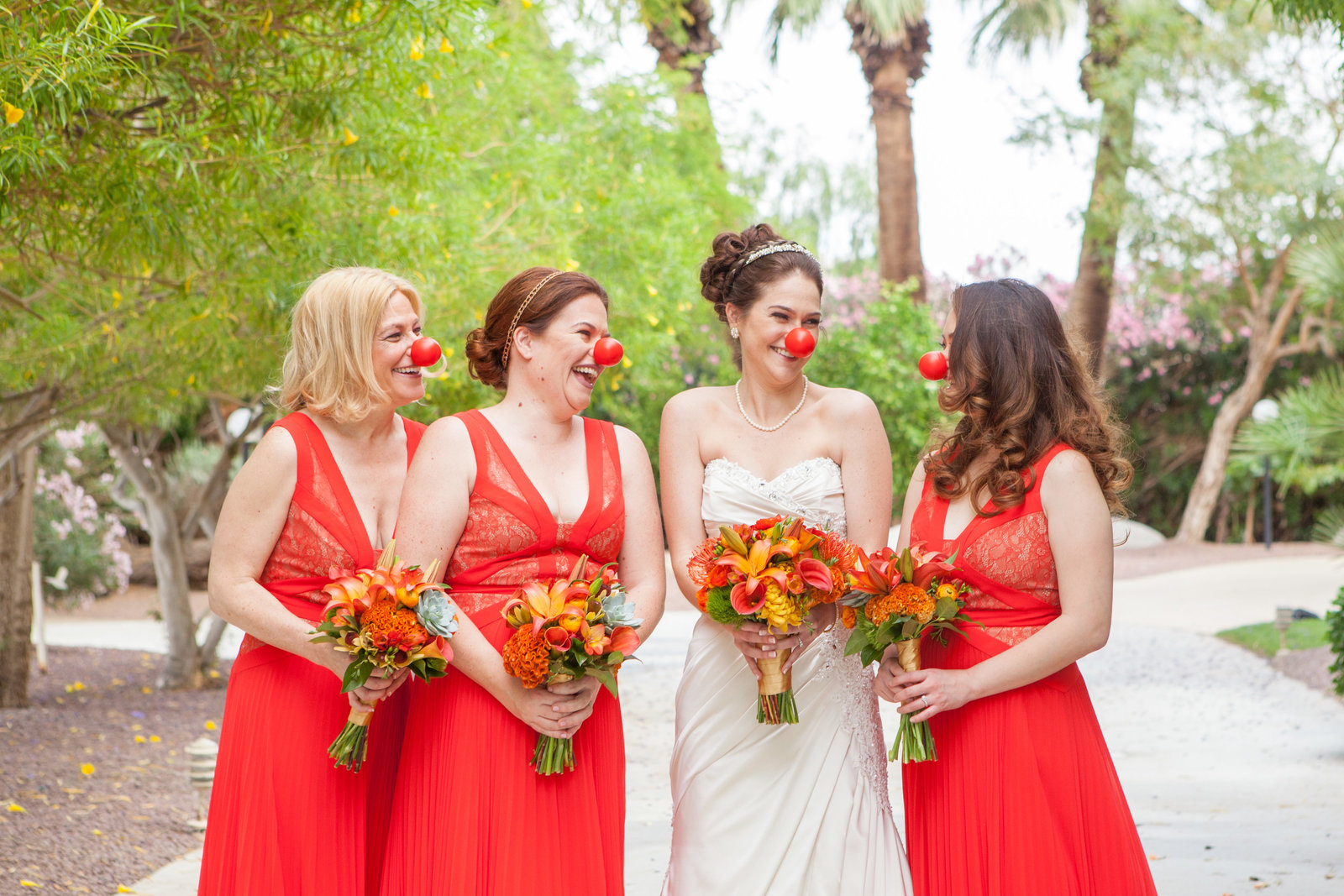 Palm Desert Swan Lake Wedding Bride and Bridesmaids with clown noses