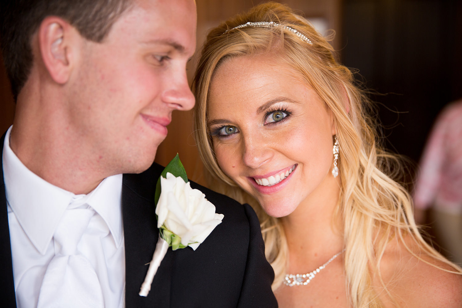 Wedding portrait of couple with beautiful smiles