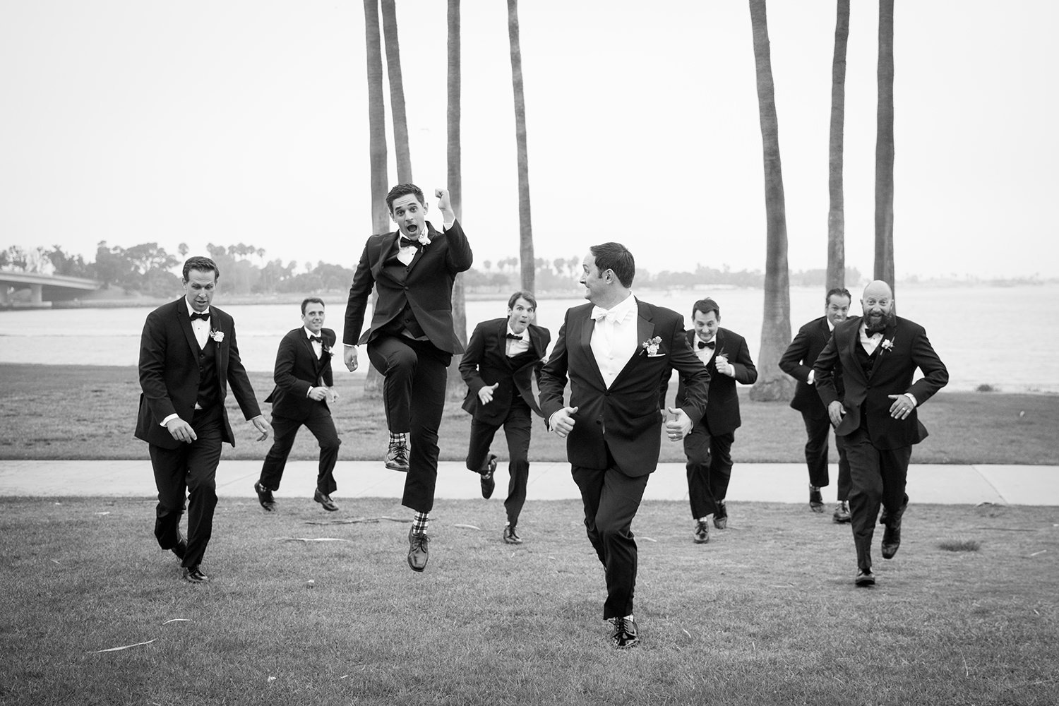 groomsman jumping in the air
