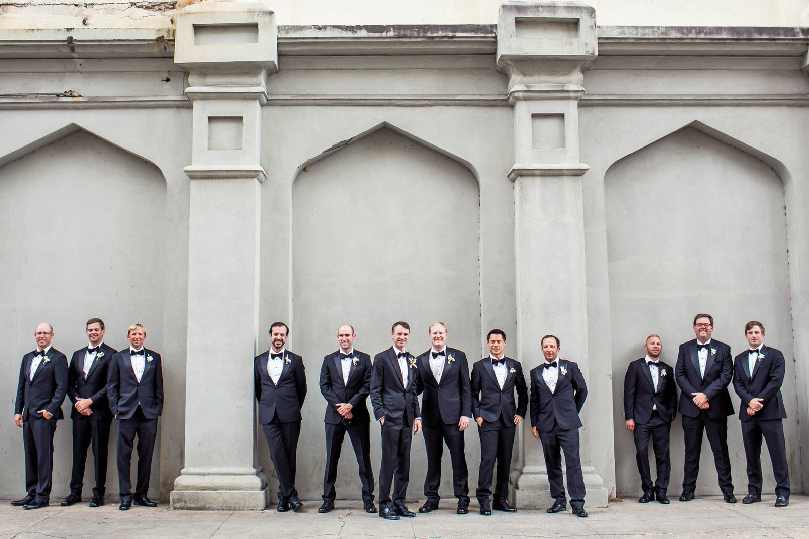 Groom and groomsmen stand in row, Grand Bohemian, Charleston, South Carolina. Kate Timbers Photography.