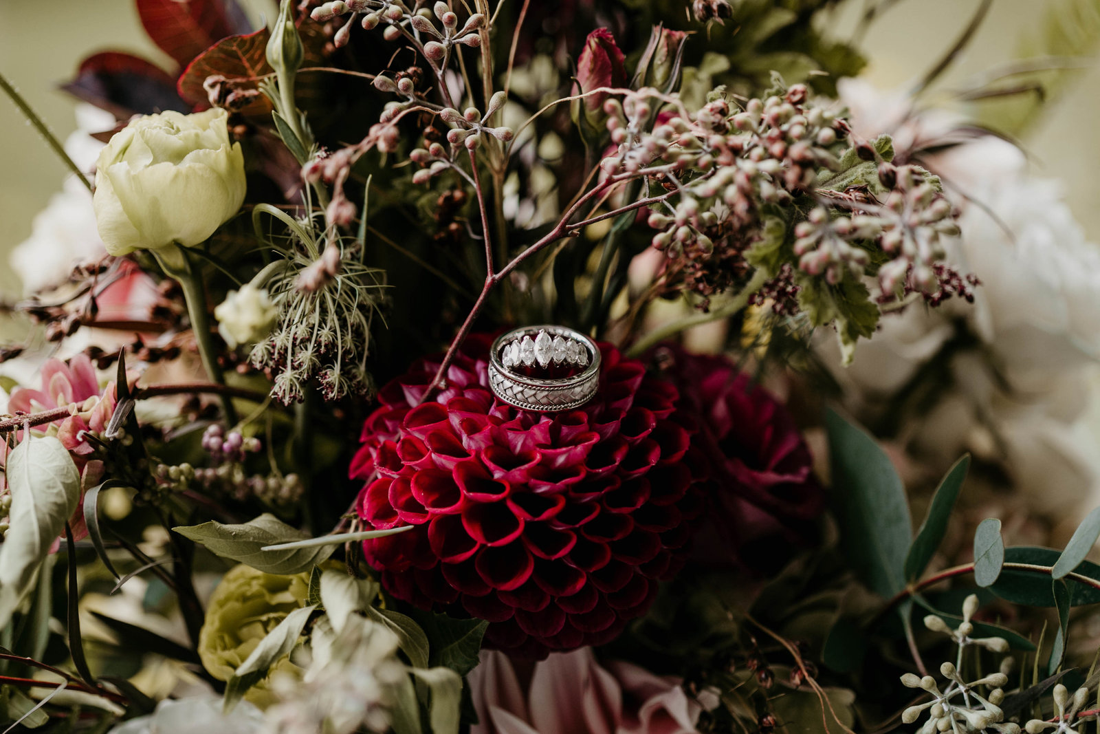 wedding rings in bridal bouquet.