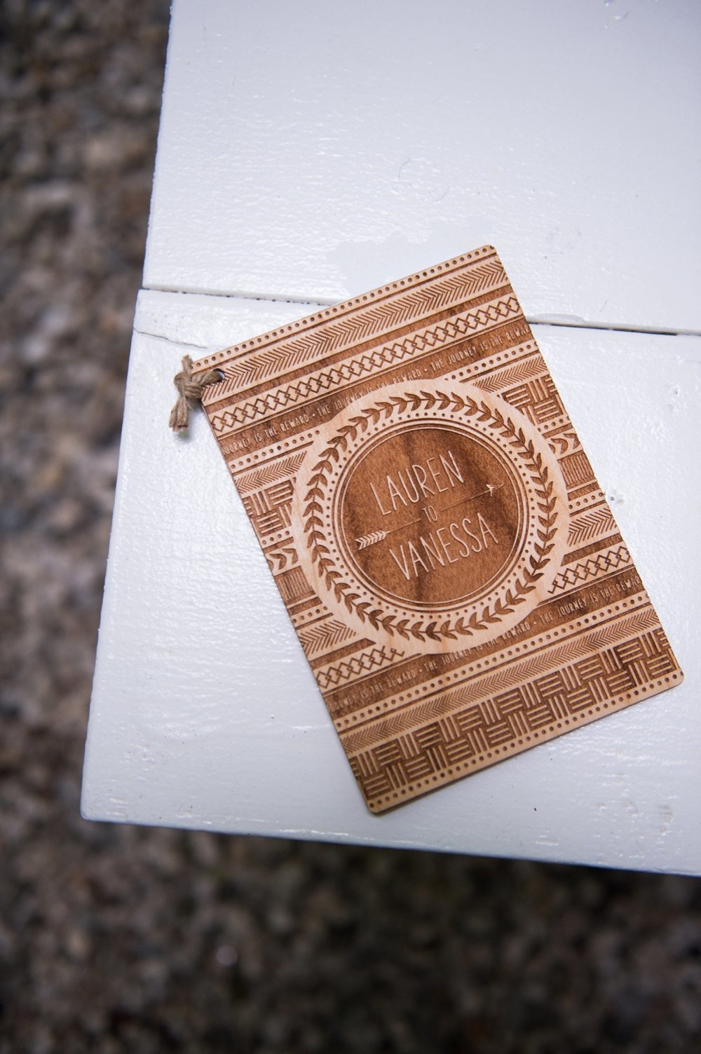 Wooden wedding ceremony program for Rustic same-sex wedding at The Barn at Walnut Hill in Maine