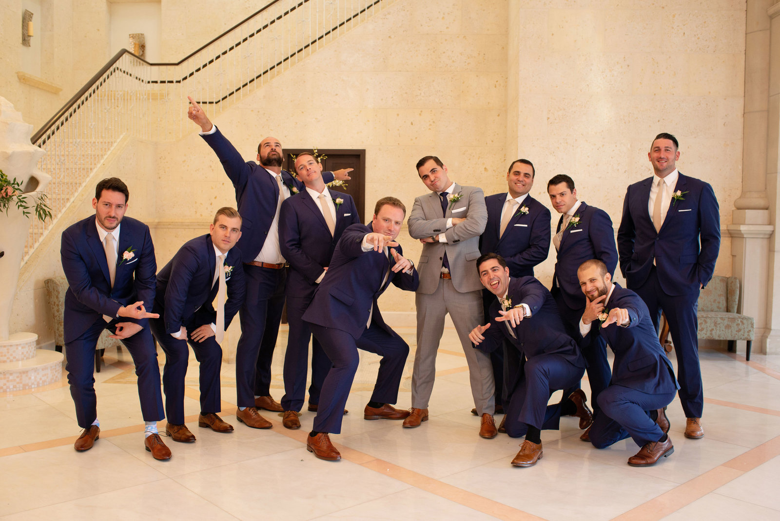 Groom and groomsmen posing at Atlantis Banquet and Events