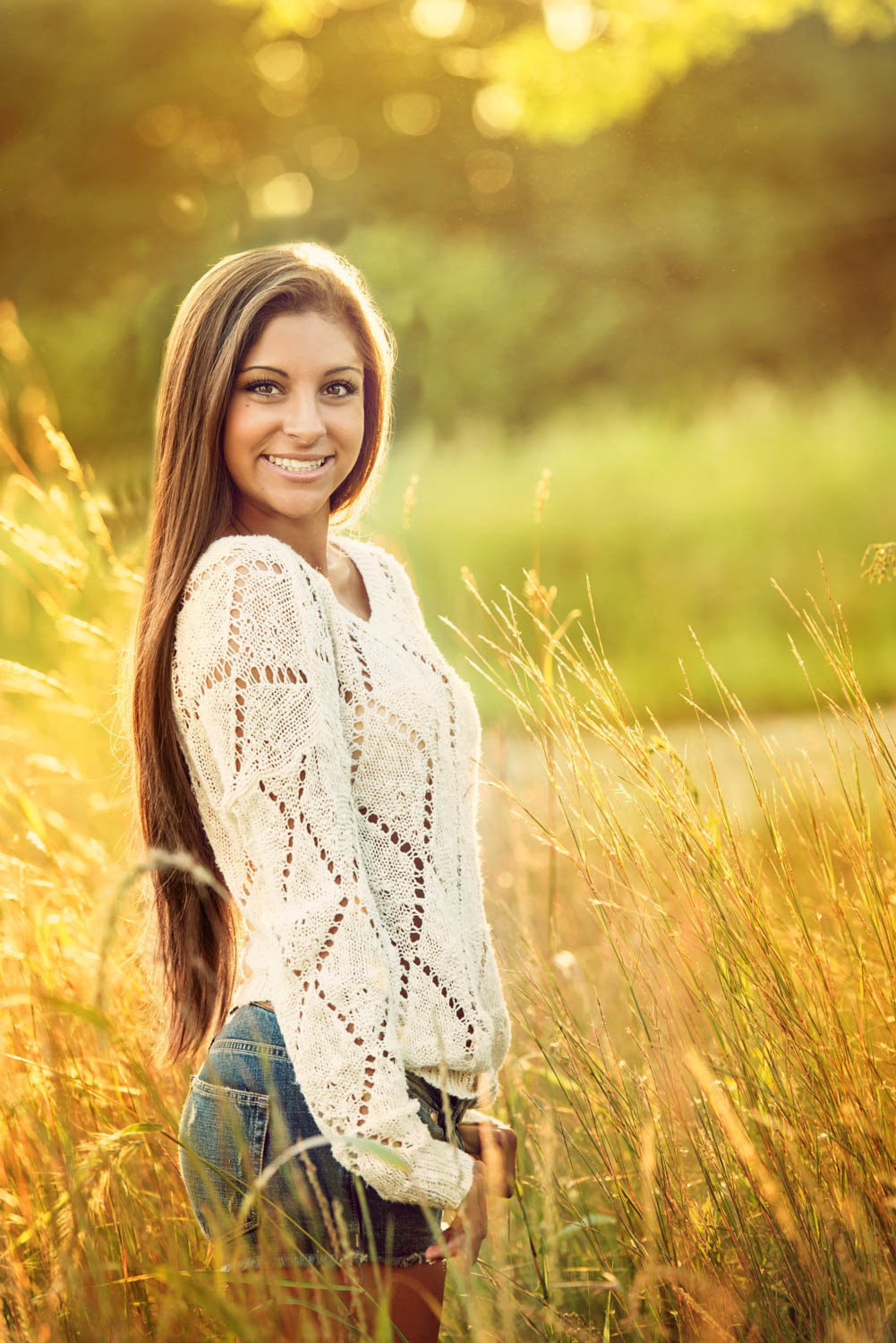 Golden hour senior picture, girl with long hair and sweater
