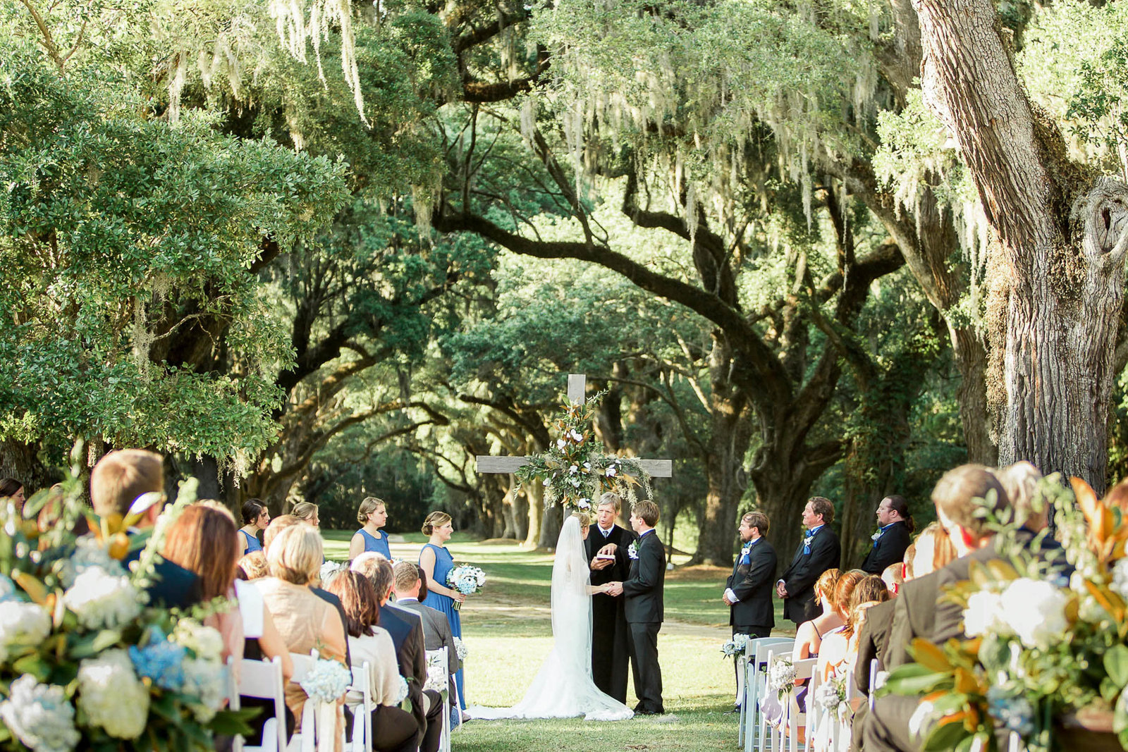Bride and groom exchange vows, Oakland Plantation, Mt Pleasant, South Carolina