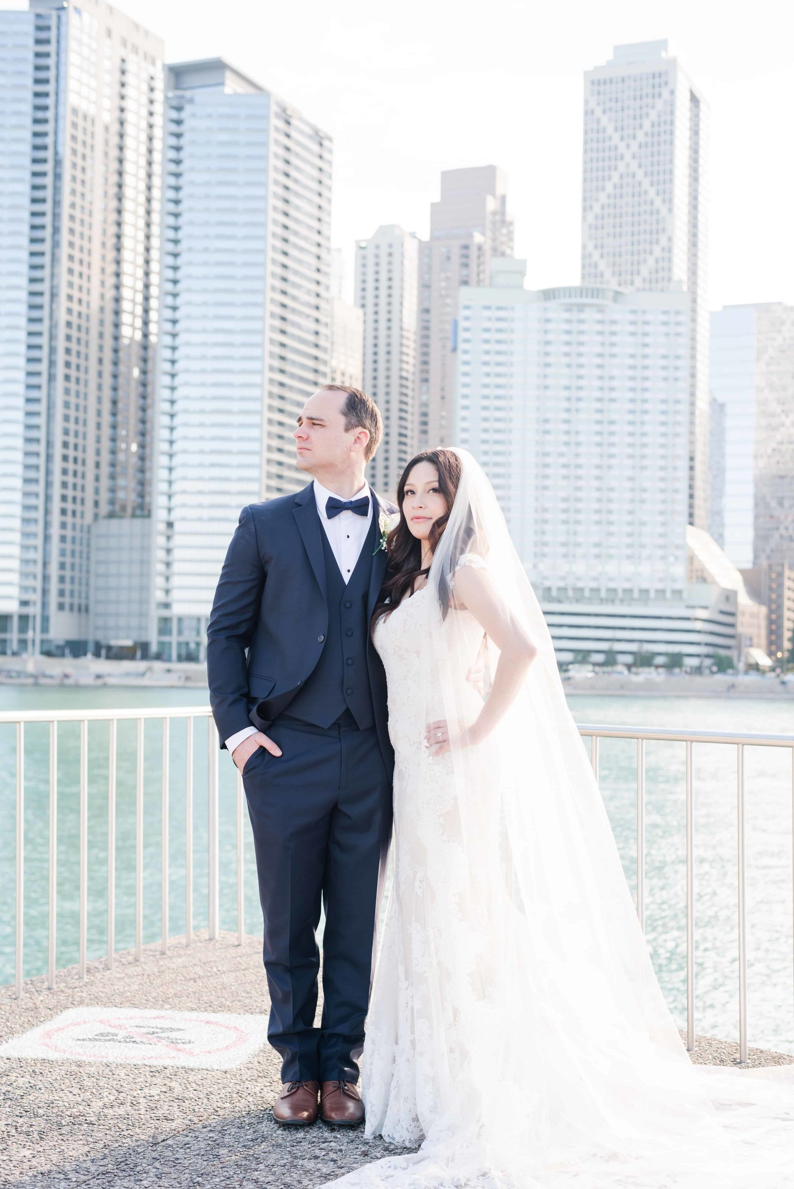 Bride and groom looking out to Navy Pier