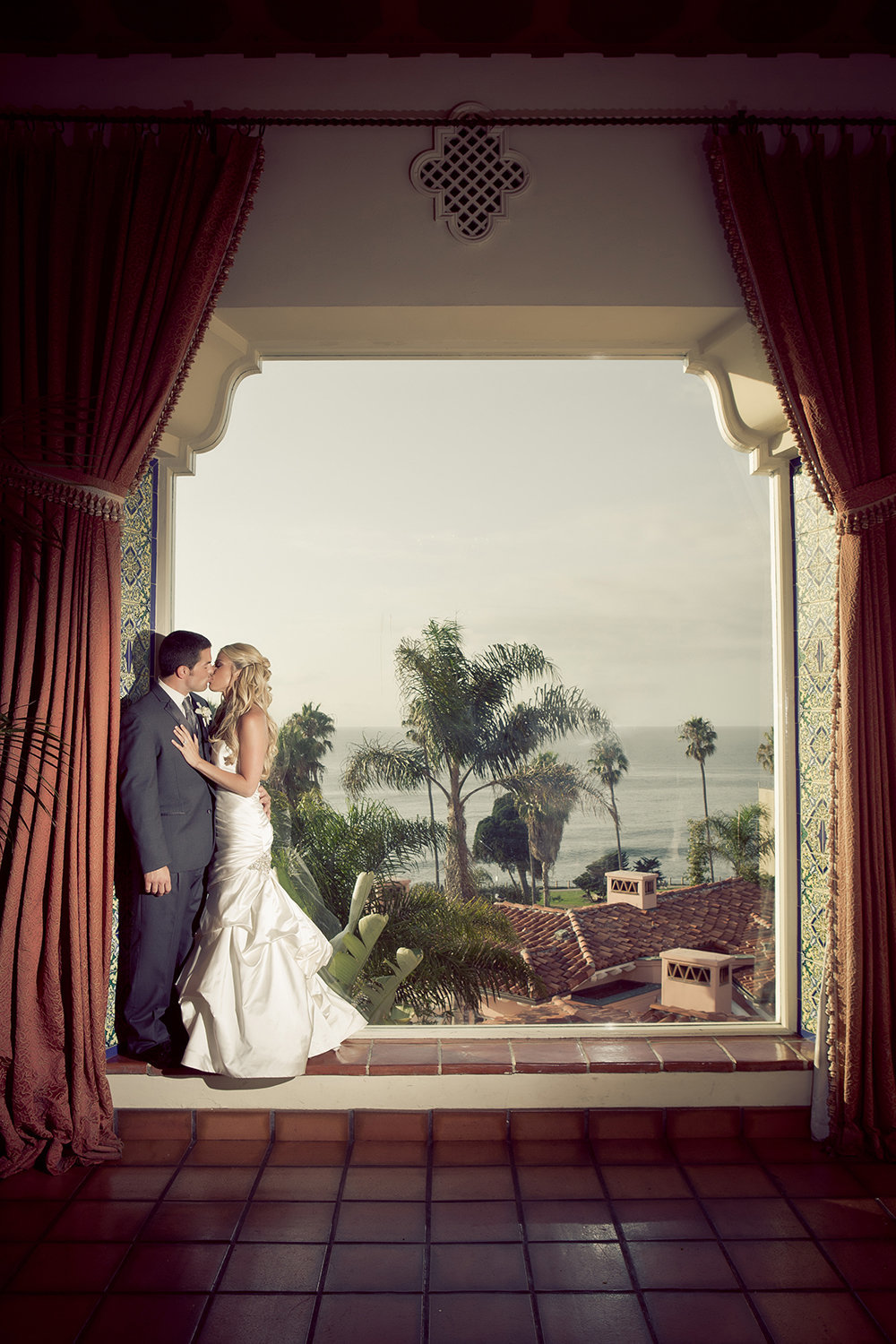 Window with a view wedding portrait at La Valencia.