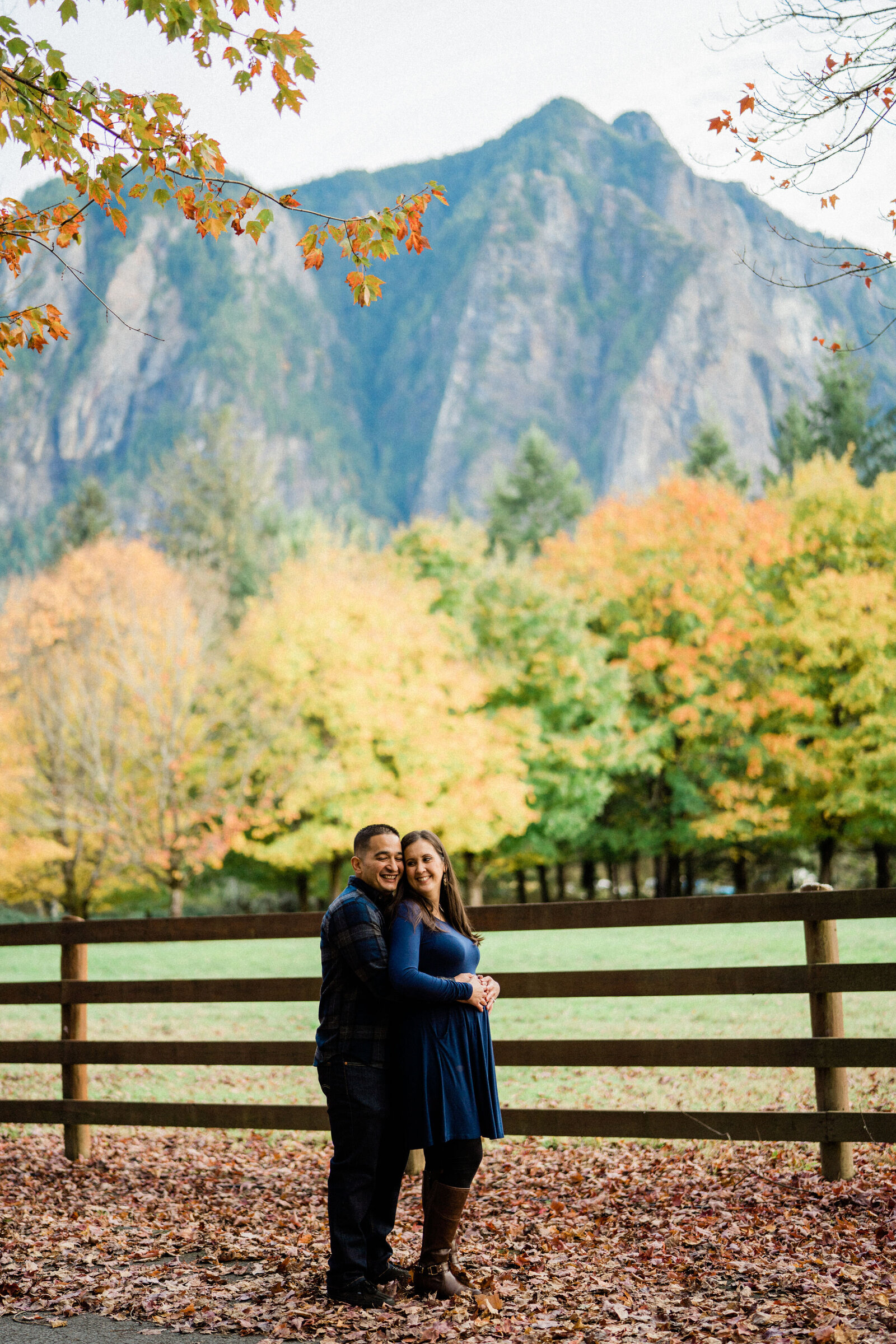 Couple standing in front of Mount Si taking engagement photos, Rockwood Farm is the best spot for engagement pictures in Seattle.
