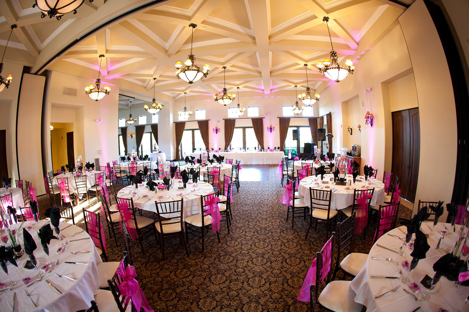 reception space at wedgewood pink uplighting